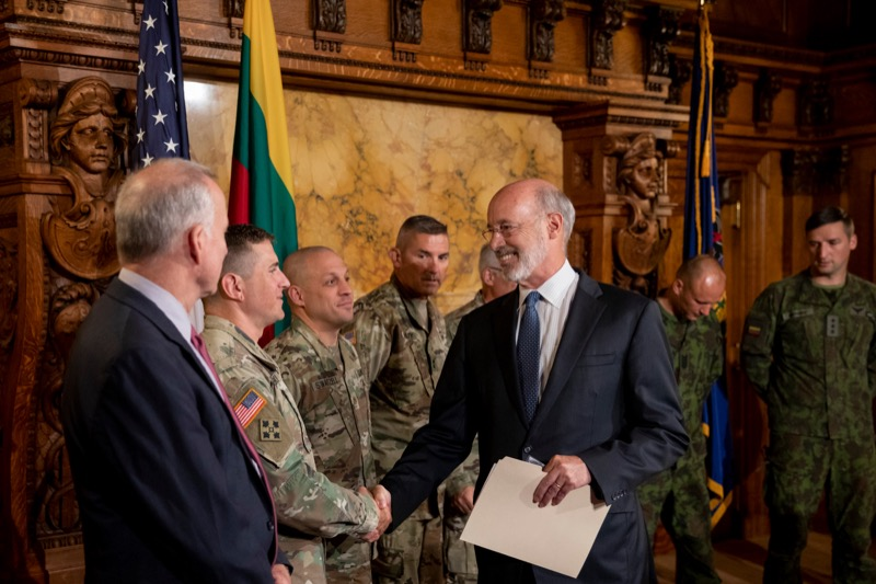 "<a href=""https://filesource.wostreaming.net/commonwealthofpa/photo/17406_GOV_Poland_Lithuania_NK_007.JPG"" target=""_blank"">⇣ Download Photo<br></a>Governor Tom Wolf shakes hands with Sgt. First Class John Nebzydoski, of the Pennsylvania Army National Guard, before outlining his plans for a trip to Lithuania and Poland inside the Governor's Reception Room at the State Capitol building in Harrisburg on Friday, September 6, 2019."