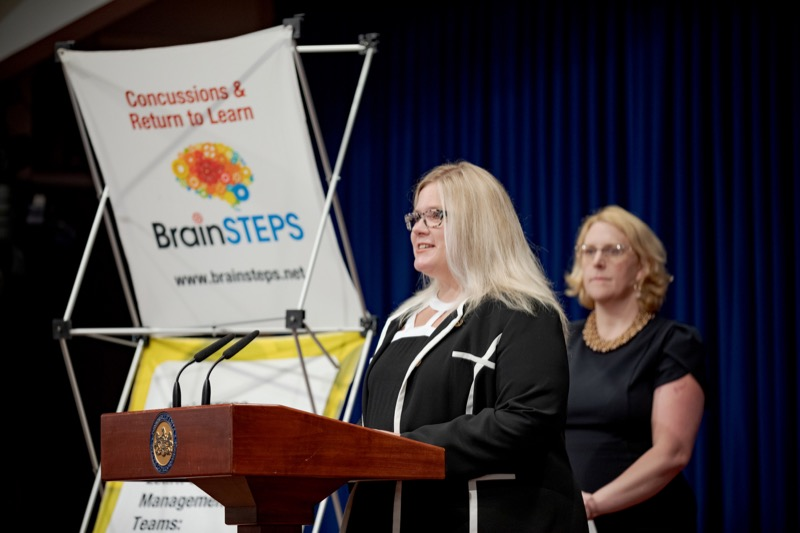 """<a href=""""https://filesource.wostreaming.net/commonwealthofpa/photo/17411_DOH_Brain_Injuries_NK_009.JPG"""" target=""""_blank"""">⇣Download Photo<br></a>Dr. Brenda Eagan-Johnson, of BrainSTEPS Brain Injury School Consulting Program, speaks during a press conference on traumatic brain injuries inside the Capitol Media Center on Thursday, September 12, 2019."""
