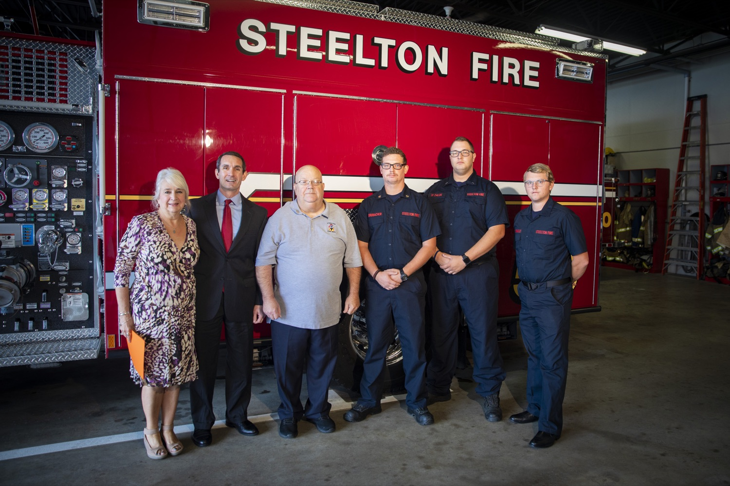 """<a href=""""https://filesource.wostreaming.net/commonwealthofpa/photo/17459_AUD_GEN_VFRA_CZ_04.JPG"""" target=""""_blank"""">⇣Download Photo<br></a>Auditor General Eugene DePasquale stands with members of the Steelton Fire Company in Steelton, PA on October 8, 2019."""