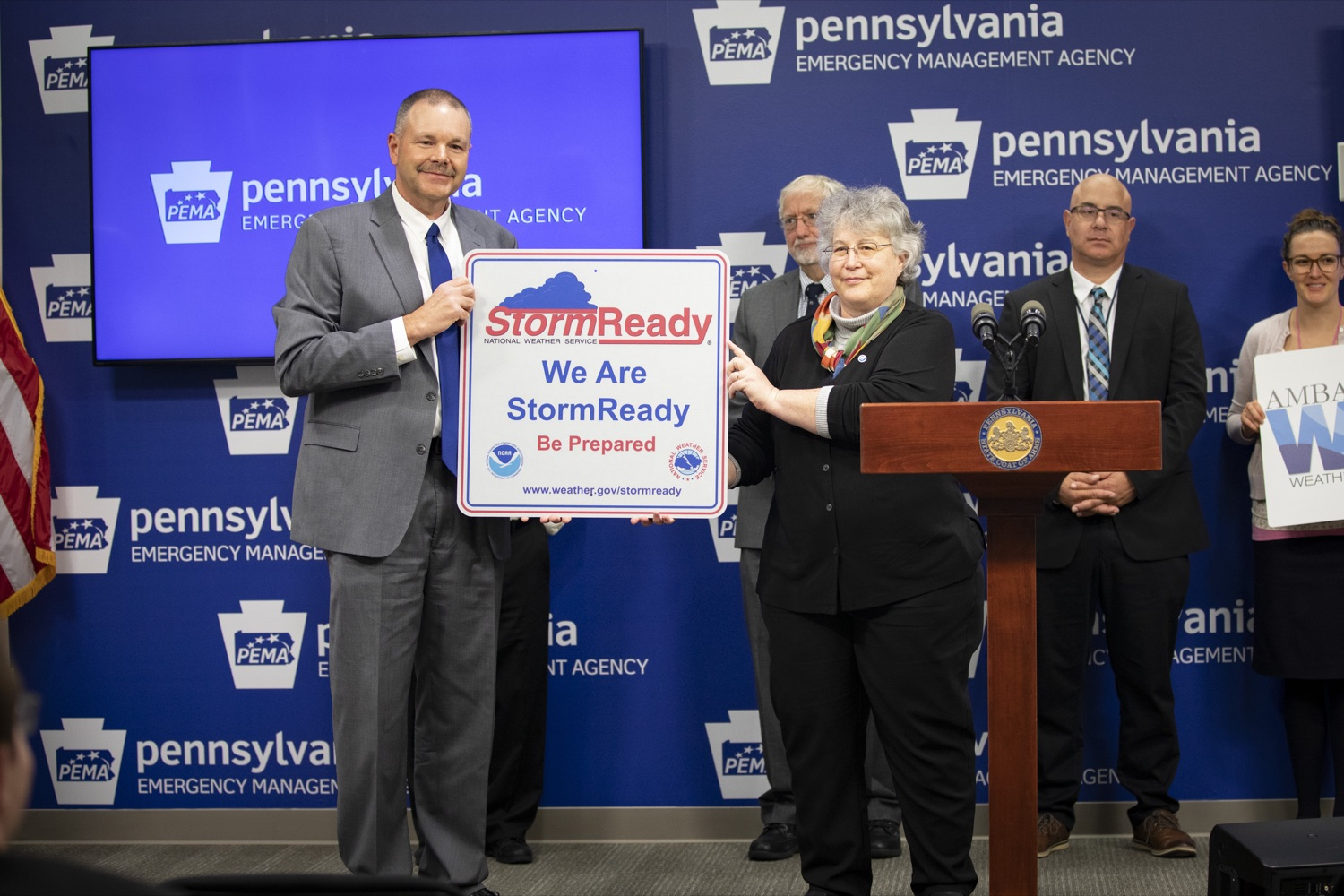"<a href=""https://filesource.wostreaming.net/commonwealthofpa/photo/17500_pema_StormReady_cz_15.JPG"" target=""_blank"">⇣ Download Photo<br></a>Barb Watson gives PEMA Director Randy Padfield proof of StormReady certification in Harrisburg on November 20, 2019."