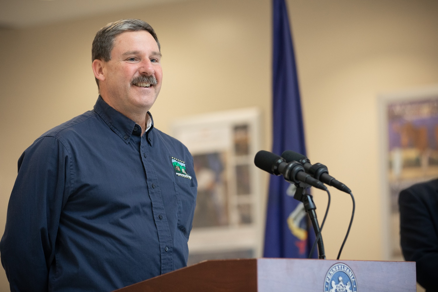 """<a href=""""https://filesource.wostreaming.net/commonwealthofpa/photo/17530_agric_homegrown_heroes_dz_007.jpg"""" target=""""_blank"""">⇣Download Photo<br></a>Jay Brown, Alpacas farmer speaks at the ceremony.  Agriculture Secretary Russell Redding and Department of Military and Veterans Affairs Brig. Gen. Mark McCormack honored members of the PA Preferred Homegrown by Heroes program for their service to our nation and to Pennsylvania, through their military service and work in agriculture. The two agencies celebrated Pennsylvanias investments in farmer-veterans in a ceremony at the Pennsylvania Farm Show Complex and Expo Center. Harrisburg, PA - Friday November, 8 2019."""