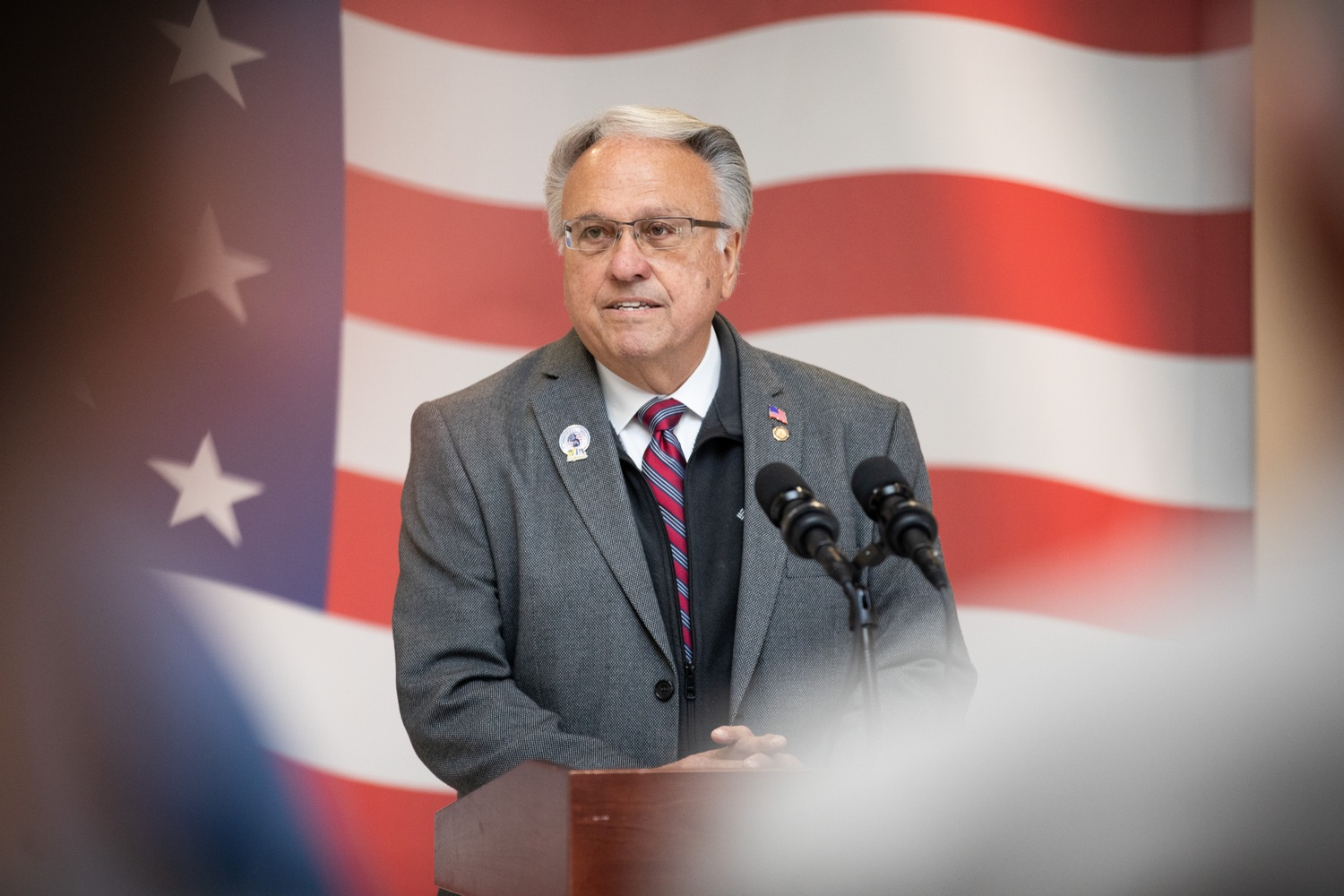 """<a href=""""https://filesource.wostreaming.net/commonwealthofpa/photo/17530_agric_homegrown_heroes_dz_017.jpg"""" target=""""_blank"""">⇣Download Photo<br></a>Representative Eddie Day Pashinski speaks at the ceremony.  Agriculture Secretary Russell Redding and Department of Military and Veterans Affairs Brig. Gen. Mark McCormack honored members of the PA Preferred Homegrown by Heroes program for their service to our nation and to Pennsylvania, through their military service and work in agriculture. The two agencies celebrated Pennsylvanias investments in farmer-veterans in a ceremony at the Pennsylvania Farm Show Complex and Expo Center. Harrisburg, PA - Friday November, 8 2019."""