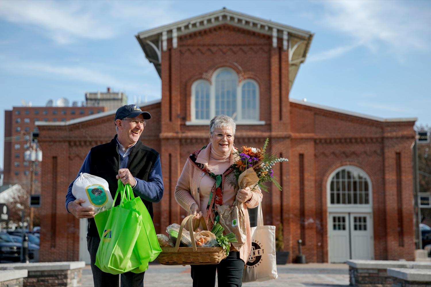 """<a href=""""https://filesource.wostreaming.net/commonwealthofpa/photo/17546_AGRIC_Buy_Local_NK_001.JPG"""" target=""""_blank"""">⇣Download Photo<br></a>Pennsylvania Department of Agriculture Secretary Russell Redding grocery shops with his wife, Nina, for Thanksgiving dinner inside Broad Street Market on Thursday, November 21, 2019."""