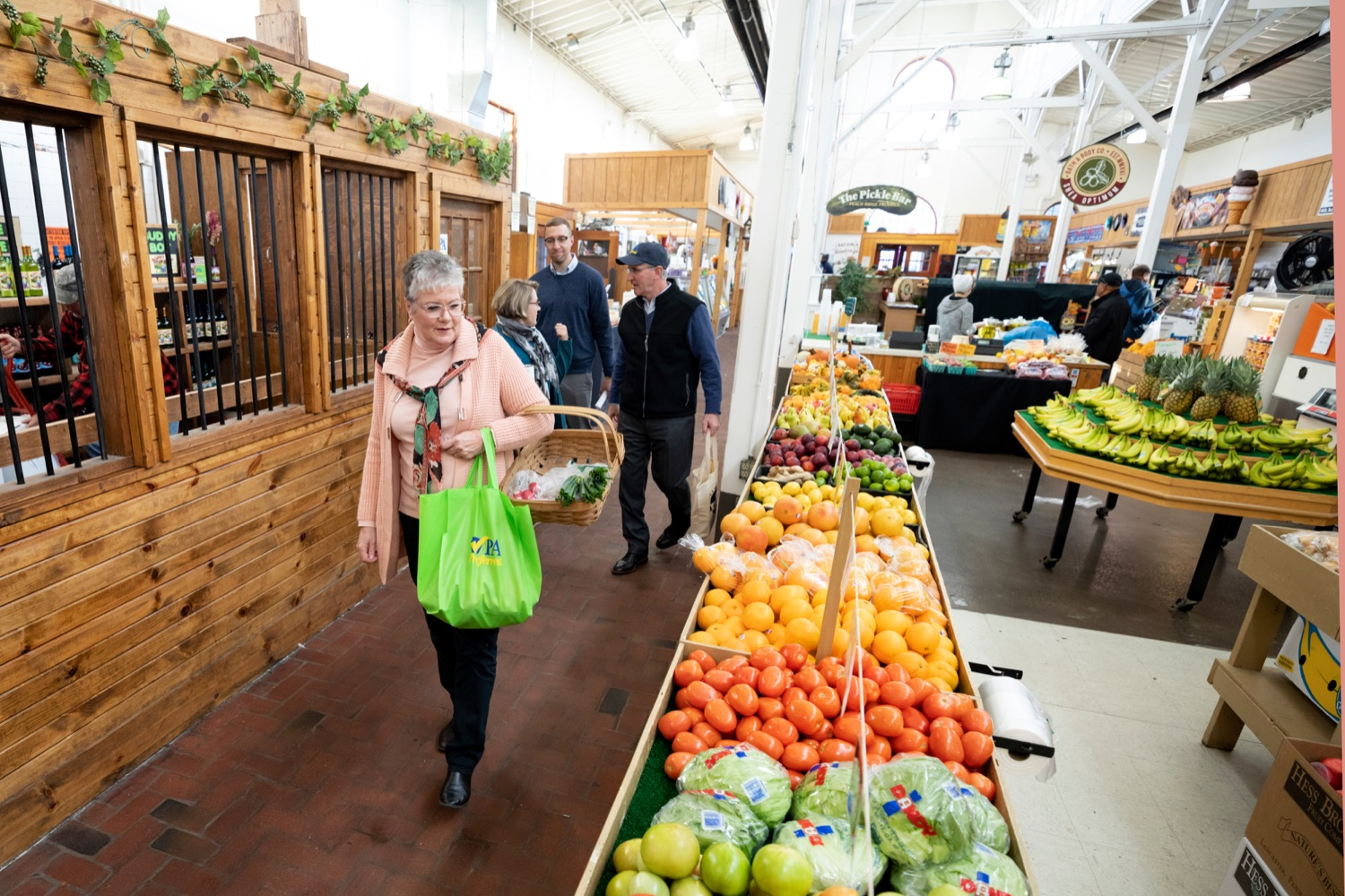 """<a href=""""https://filesource.wostreaming.net/commonwealthofpa/photo/17546_AGRIC_Buy_Local_NK_008.JPG"""" target=""""_blank"""">⇣Download Photo<br></a>Pennsylvania Department of Agriculture Secretary Russell Redding grocery shops with his wife, Nina, for Thanksgiving dinner inside Broad Street Market on Thursday, November 21, 2019."""