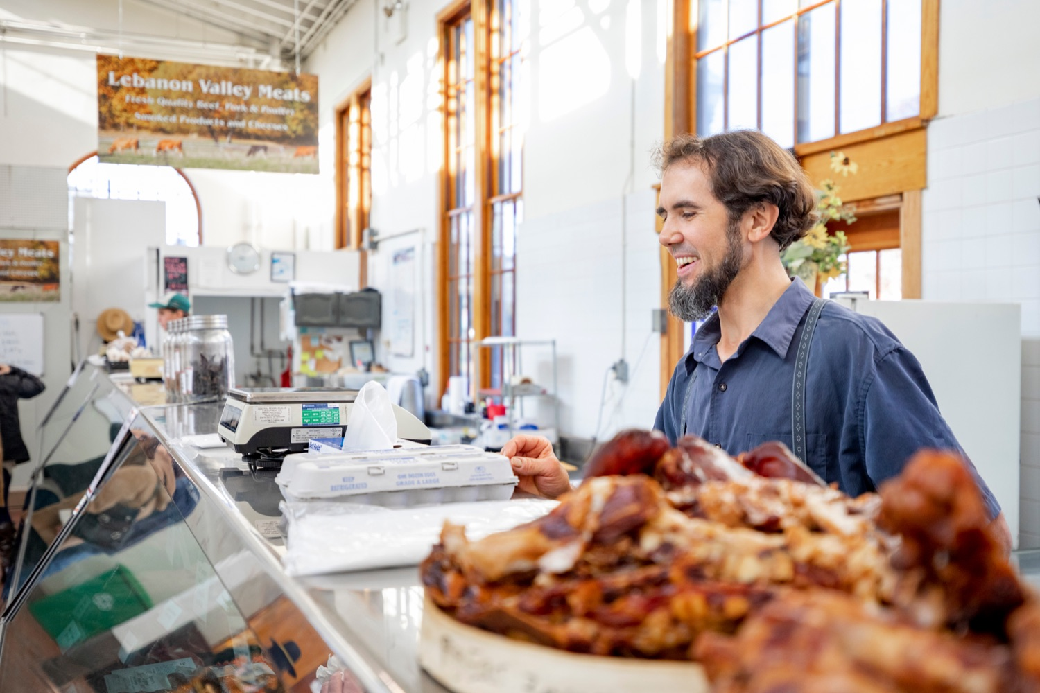 """<a href=""""https://filesource.wostreaming.net/commonwealthofpa/photo/17546_AGRIC_Buy_Local_NK_015.JPG"""" target=""""_blank"""">⇣Download Photo<br></a>Steve Stoltzfus, owner of Lebanon Valley Meats, grabs two dozen eggs for Pennsylvania Department of Agriculture Secretary Russell Redding inside Broad Street Market on Thursday, November 21, 2019."""