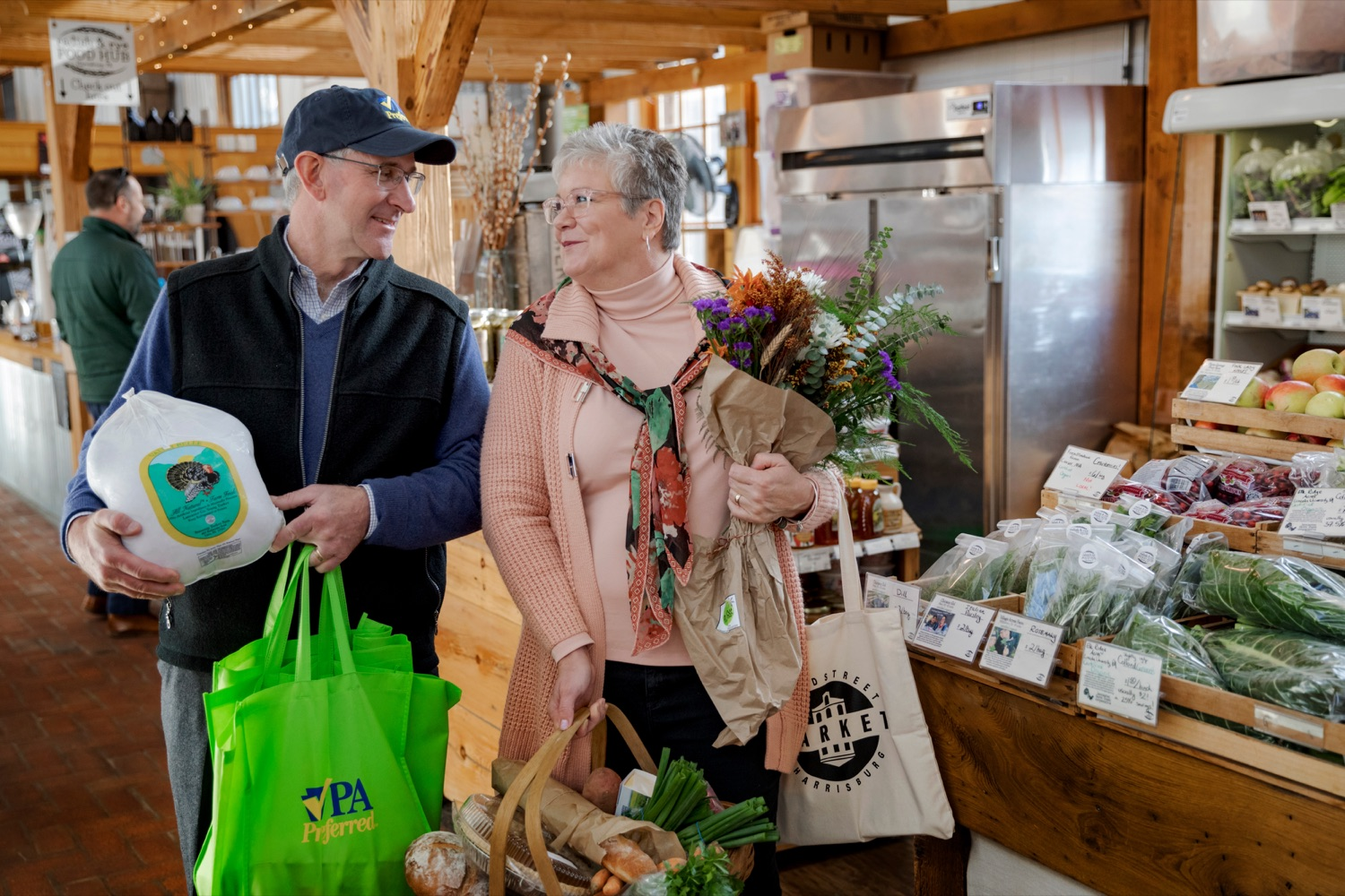 """<a href=""""https://filesource.wostreaming.net/commonwealthofpa/photo/17546_AGRIC_Buy_Local_NK_017.JPG"""" target=""""_blank"""">⇣Download Photo<br></a>Pennsylvania Department of Agriculture Secretary Russell Redding grocery shops with his wife, Nina, for Thanksgiving dinner inside Broad Street Market on Thursday, November 21, 2019."""