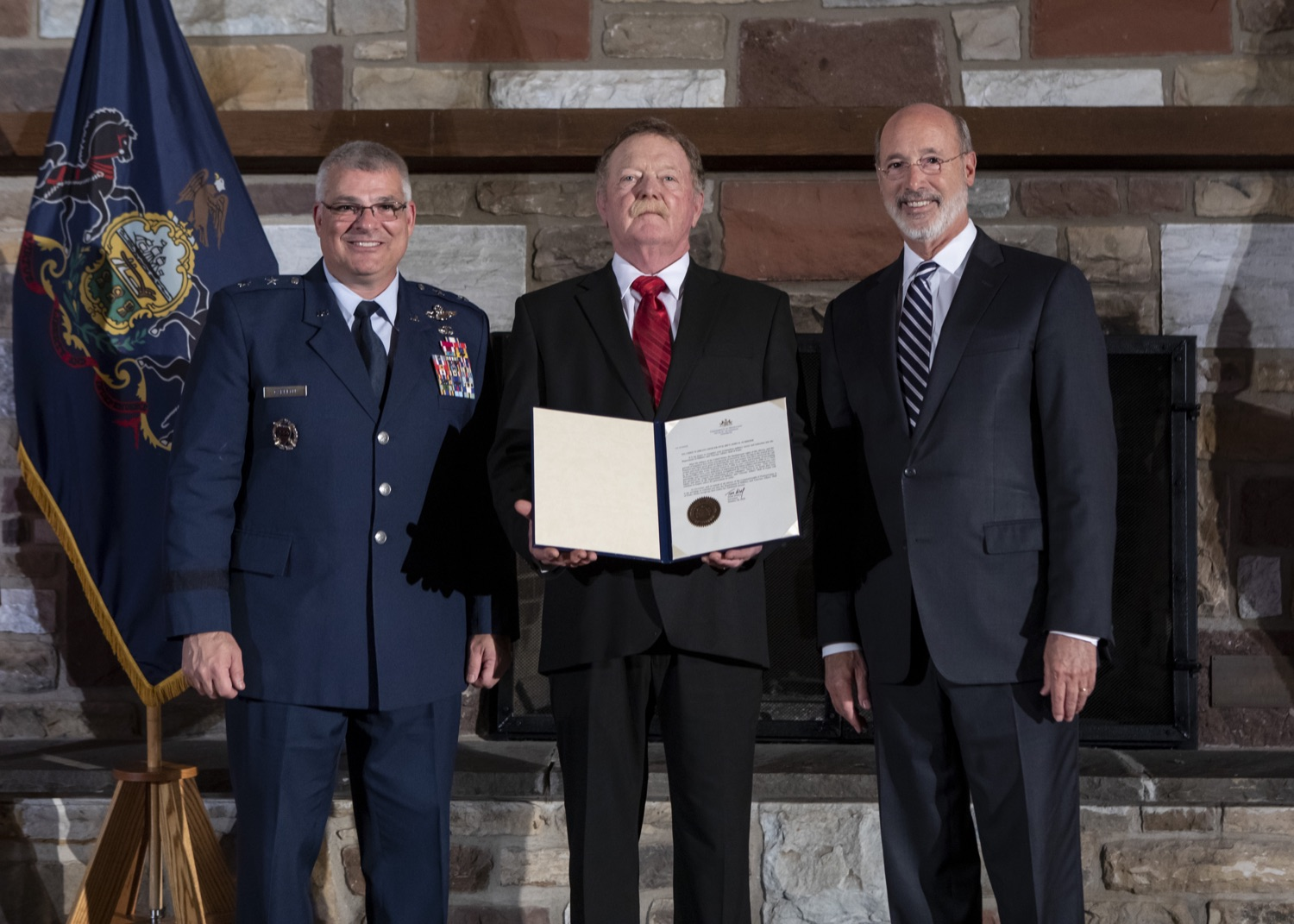 """<a href=""""https://filesource.wostreaming.net/commonwealthofpa/photo/17557_gov_dmva_rjw_014.jpg"""" target=""""_blank"""">⇣Download Photo<br></a>Governor Tom Wolf helped to honor two members inducted today into the Pennsylvania Department of Military and Veterans Affairs prestigious Hall of Fame, recognizing their exceptional service to the department that supports Pennsylvanias nearly 800,000 veterans and 18,000 members of the National Guard.  Chief Warrant Officer 5 (ret.) John K. Schreier of Selinsgrove, Snyder County; and John A. Brenner (posthumously) of Mt. Wolf, York County, are the 2019 inductees."""