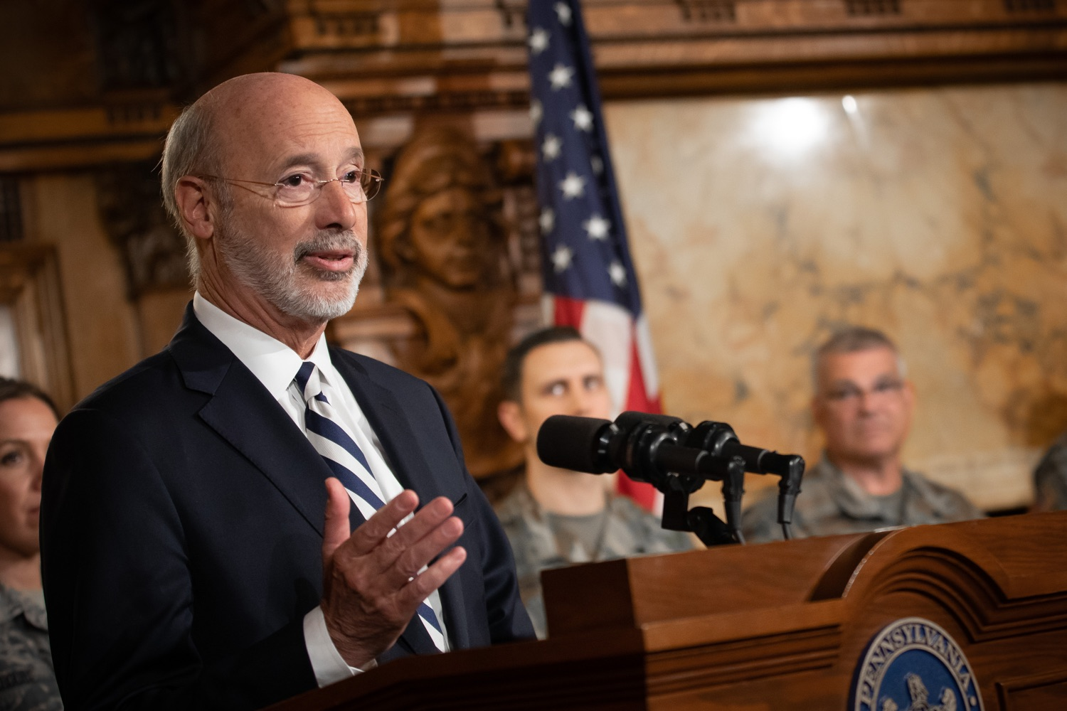 """<a href=""""https://filesource.wostreaming.net/commonwealthofpa/photo/17563_gov_giBill_dz_001.jpg"""" target=""""_blank"""">⇣Download Photo<br></a>Governor Tom Wolf speaking at the announcement. Governor Tom Wolf, joined by Pennsylvanias adjutant general and head of the Department of Military and Veterans Affairs Maj. Gen. Anthony Carelli, legislators and PA National Guard members and their families, encouraged PA National Guard members to take advantage of the new Military Family Education Program, or PA GI bill, now open for enrollment. Harrisburg, PA Monday, November 4 2019"""
