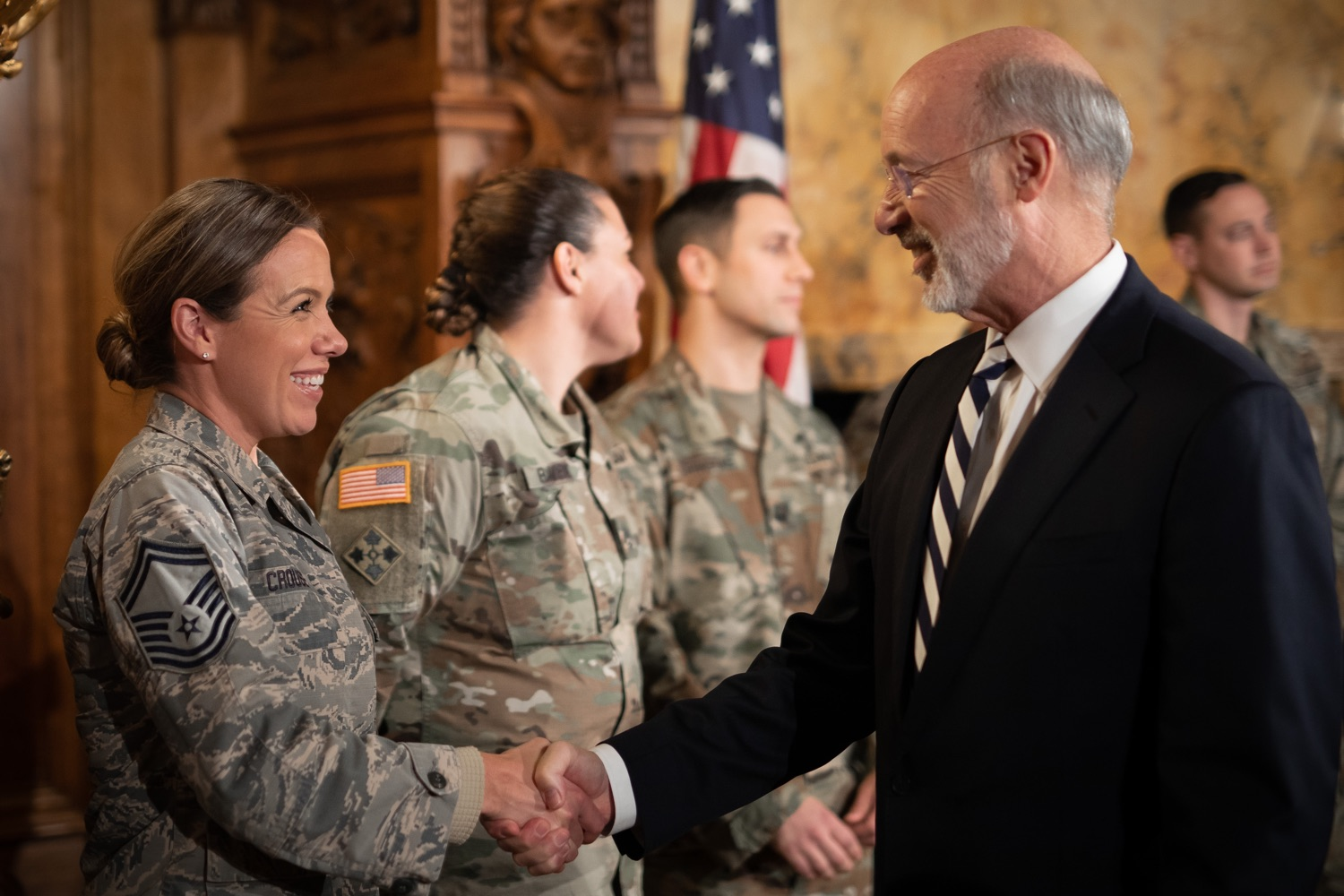 """<a href=""""https://filesource.wostreaming.net/commonwealthofpa/photo/17563_gov_giBill_dz_003.jpg"""" target=""""_blank"""">⇣Download Photo<br></a>Governor Tom Wolf greeting atendees. Governor Tom Wolf, joined by Pennsylvanias adjutant general and head of the Department of Military and Veterans Affairs Maj. Gen. Anthony Carelli, legislators and PA National Guard members and their families, encouraged PA National Guard members to take advantage of the new Military Family Education Program, or PA GI bill, now open for enrollment. Harrisburg, PA Monday, November 4 2019"""