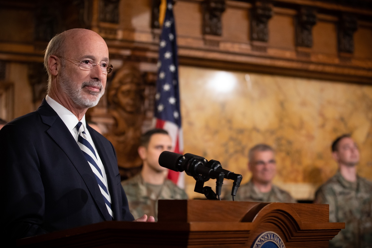 """<a href=""""https://filesource.wostreaming.net/commonwealthofpa/photo/17563_gov_giBill_dz_004.jpg"""" target=""""_blank"""">⇣Download Photo<br></a>Governor Tom Wolf speaking at the announcement. Governor Tom Wolf, joined by Pennsylvanias adjutant general and head of the Department of Military and Veterans Affairs Maj. Gen. Anthony Carelli, legislators and PA National Guard members and their families, encouraged PA National Guard members to take advantage of the new Military Family Education Program, or PA GI bill, now open for enrollment. Harrisburg, PA Monday, November 4 2019"""
