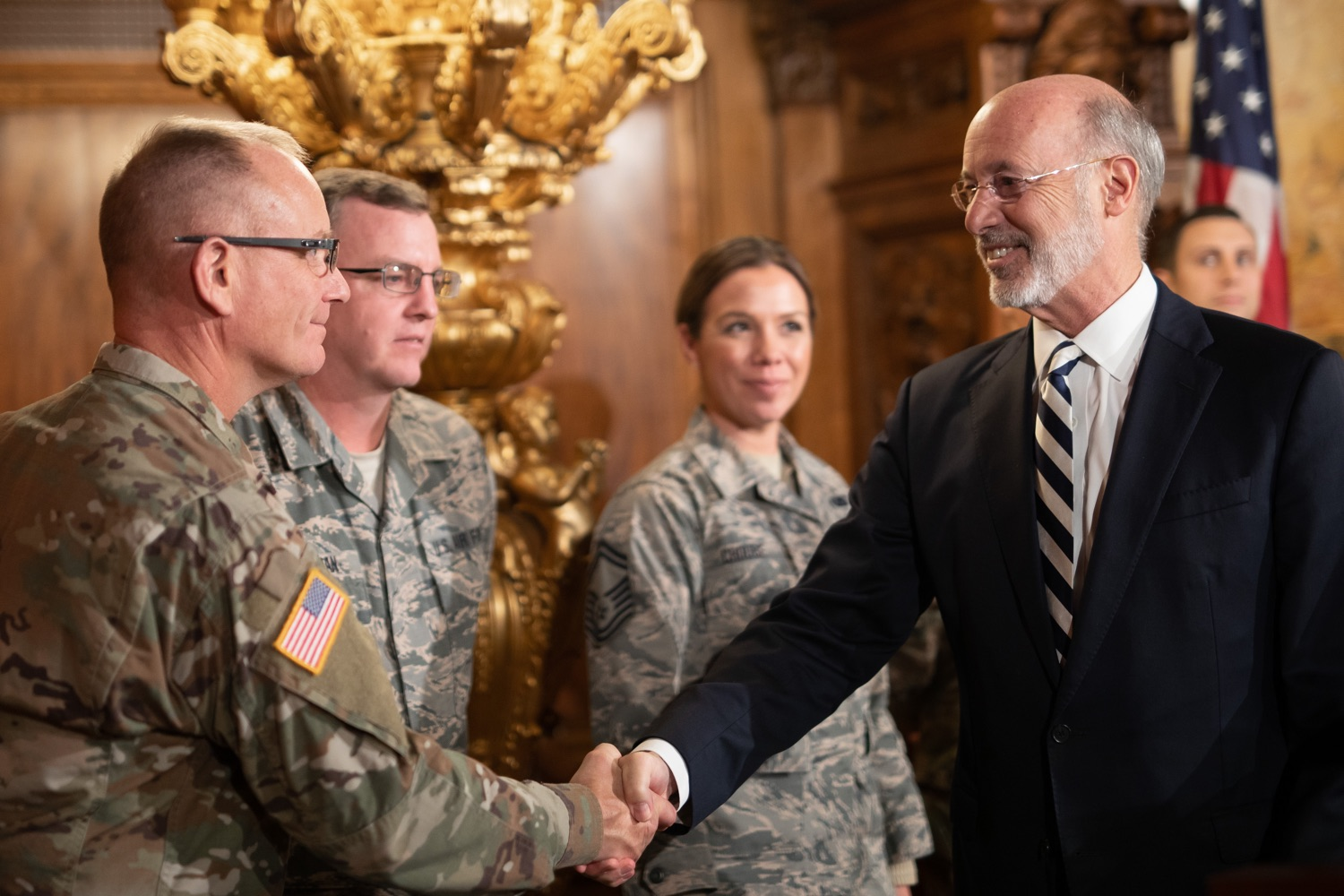 """<a href=""""https://filesource.wostreaming.net/commonwealthofpa/photo/17563_gov_giBill_dz_007.jpg"""" target=""""_blank"""">⇣Download Photo<br></a>Governor Tom Wolf greeting atendees. Governor Tom Wolf, joined by Pennsylvanias adjutant general and head of the Department of Military and Veterans Affairs Maj. Gen. Anthony Carelli, legislators and PA National Guard members and their families, encouraged PA National Guard members to take advantage of the new Military Family Education Program, or PA GI bill, now open for enrollment. Harrisburg, PA Monday, November 4 2019"""