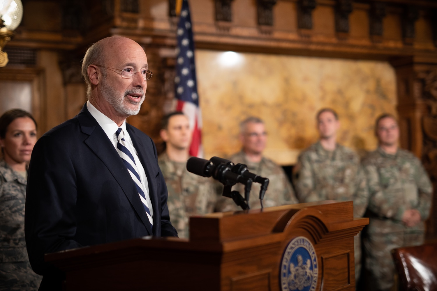 """<a href=""""https://filesource.wostreaming.net/commonwealthofpa/photo/17563_gov_giBill_dz_008.jpg"""" target=""""_blank"""">⇣Download Photo<br></a>Governor Tom Wolf speaking at the announcement. Governor Tom Wolf, joined by Pennsylvanias adjutant general and head of the Department of Military and Veterans Affairs Maj. Gen. Anthony Carelli, legislators and PA National Guard members and their families, encouraged PA National Guard members to take advantage of the new Military Family Education Program, or PA GI bill, now open for enrollment. Harrisburg, PA Monday, November 4 2019"""