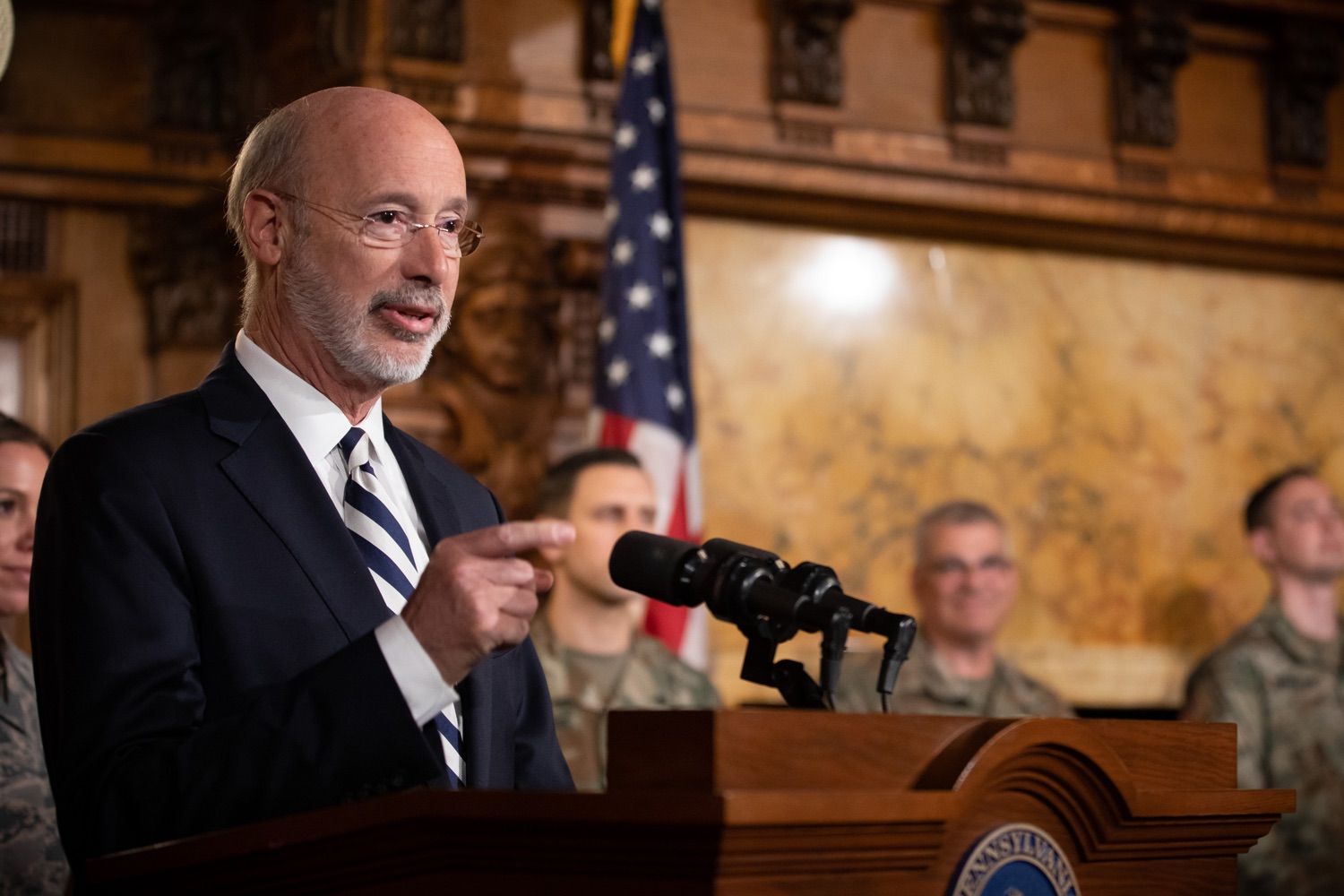 """<a href=""""https://filesource.wostreaming.net/commonwealthofpa/photo/17563_gov_giBill_dz_014.jpg"""" target=""""_blank"""">⇣Download Photo<br></a>Governor Tom Wolf speaking at the announcement. Governor Tom Wolf, joined by Pennsylvanias adjutant general and head of the Department of Military and Veterans Affairs Maj. Gen. Anthony Carelli, legislators and PA National Guard members and their families, encouraged PA National Guard members to take advantage of the new Military Family Education Program, or PA GI bill, now open for enrollment. Harrisburg, PA Monday, November 4 2019"""