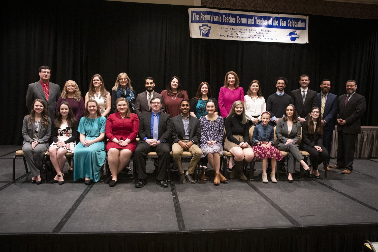 "<a href=""https://filesource.wostreaming.net/commonwealthofpa/photo/17584_pde_teacher_award_07.JPG"" target=""_blank"">⇣ Download Photo<br></a>The 12 Teacher of the Year finalists pose with other notable Pennsylvania educators, at the Hershey Lodge in Hershey on December 9, 2019."