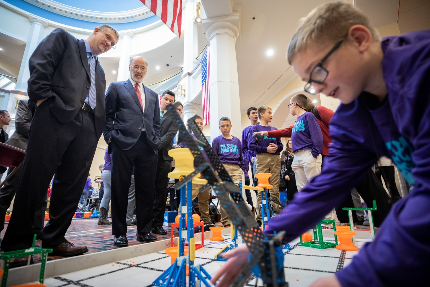 """<a href=""""https://filesource.wostreaming.net/commonwealthofpa/photo/17587_gov_pasmart_rural_robotics_dz_004.jpg"""" target=""""_blank"""">⇣Download Photo<br></a>Pennsylvania Governor Tom Wolf meeting with students at the robotics demonstration.  Celebrating the success of the PAsmart workforce development program to create educational opportunities at schools across the commonwealth, Governor Tom Wolf welcomed more than 50 students from the Pennsylvania Rural Robotics Initiative to the Capitol today. The students from nine western Pennsylvania school districts showcased their skills in coding, robotics and drone technology. The Wolf administration awarded the initiative a $299,000 PAsmart Advancing Grant earlier this year. Harrisburg, PA  Tuesday, November 12, 2019"""
