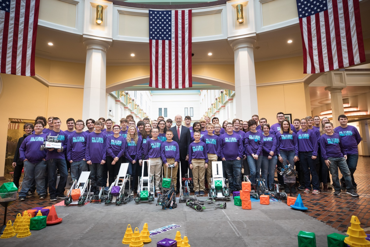 """<a href=""""https://filesource.wostreaming.net/commonwealthofpa/photo/17587_gov_pasmart_rural_robotics_dz_006.jpg"""" target=""""_blank"""">⇣Download Photo<br></a>Pennsylvania Governor Tom Wolf posing with students at the robotics demonstration.  Celebrating the success of the PAsmart workforce development program to create educational opportunities at schools across the commonwealth, Governor Tom Wolf welcomed more than 50 students from the Pennsylvania Rural Robotics Initiative to the Capitol today. The students from nine western Pennsylvania school districts showcased their skills in coding, robotics and drone technology. The Wolf administration awarded the initiative a $299,000 PAsmart Advancing Grant earlier this year. Harrisburg, PA  Tuesday, November 12, 2019"""