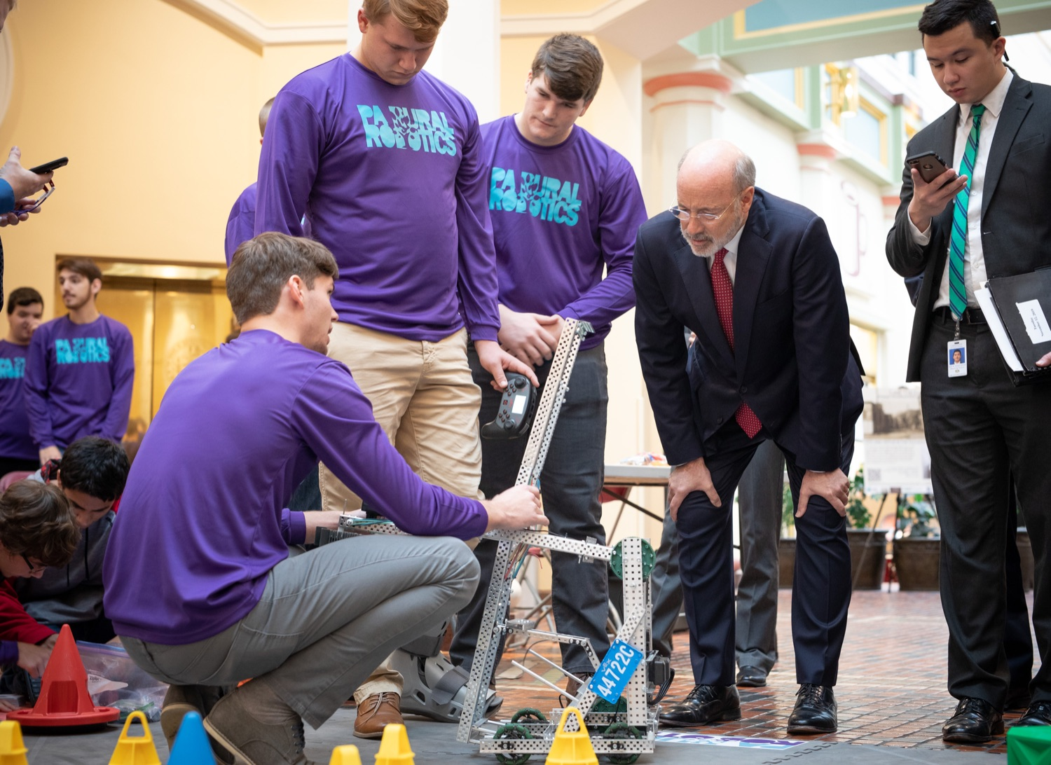 """<a href=""""https://filesource.wostreaming.net/commonwealthofpa/photo/17587_gov_pasmart_rural_robotics_dz_007.jpg"""" target=""""_blank"""">⇣Download Photo<br></a>Pennsylvania Governor Tom Wolf meeting with students at the robotics demonstration.  Celebrating the success of the PAsmart workforce development program to create educational opportunities at schools across the commonwealth, Governor Tom Wolf welcomed more than 50 students from the Pennsylvania Rural Robotics Initiative to the Capitol today. The students from nine western Pennsylvania school districts showcased their skills in coding, robotics and drone technology. The Wolf administration awarded the initiative a $299,000 PAsmart Advancing Grant earlier this year. Harrisburg, PA  Tuesday, November 12, 2019"""