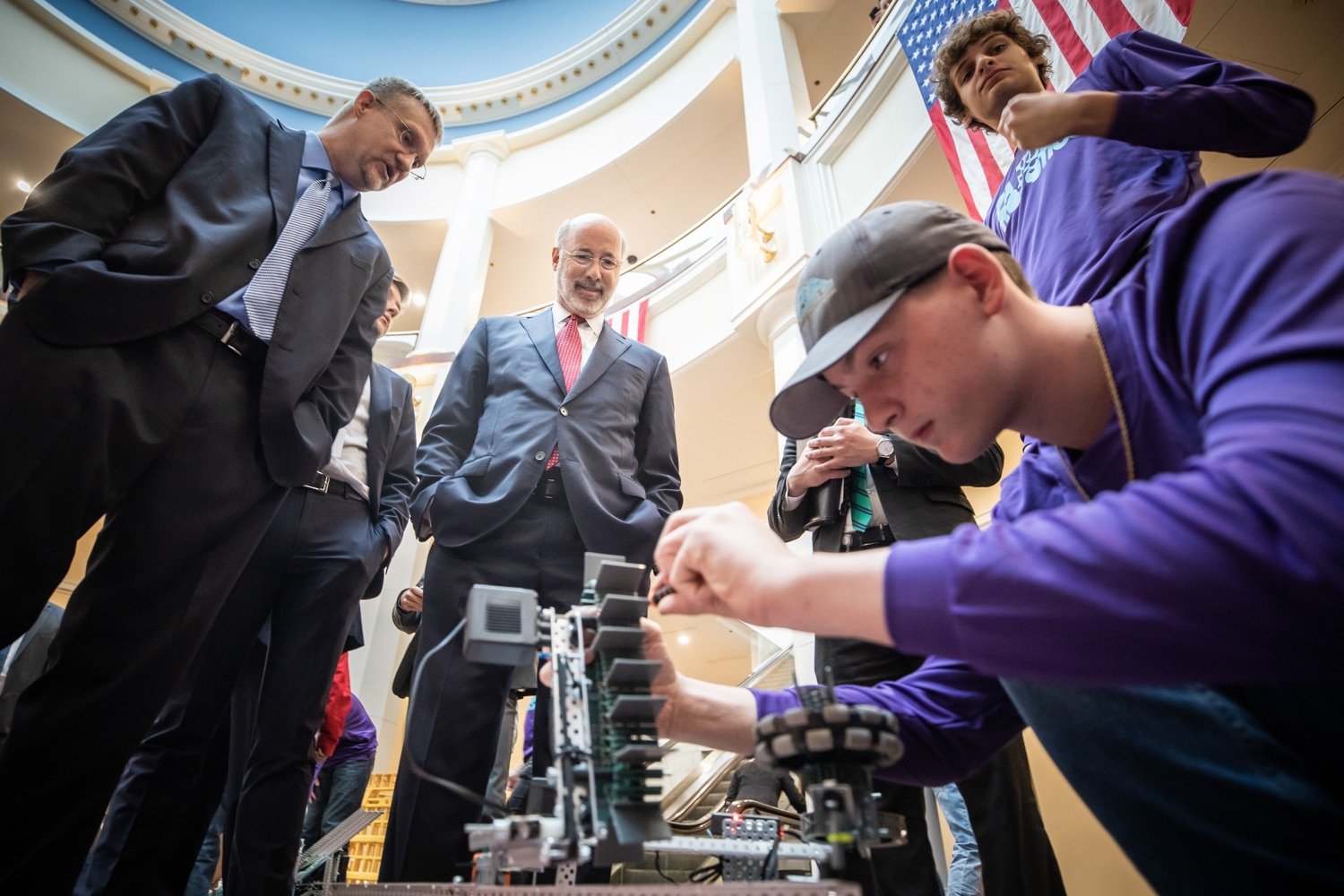 """<a href=""""https://filesource.wostreaming.net/commonwealthofpa/photo/17587_gov_pasmart_rural_robotics_dz_014.jpg"""" target=""""_blank"""">⇣Download Photo<br></a>Pennsylvania Governor Tom Wolf meeting with students at the robotics demonstration.Celebrating the success of the PAsmart workforce development program to create educational opportunities at schools across the commonwealth, Governor Tom Wolf welcomed more than 50 students from the Pennsylvania Rural Robotics Initiative to the Capitol today. The students from nine western Pennsylvania school districts showcased their skills in coding, robotics and drone technology. The Wolf administration awarded the initiative a $299,000 PAsmart Advancing Grant earlier this year. Harrisburg, PA  Tuesday, November 12, 2019"""