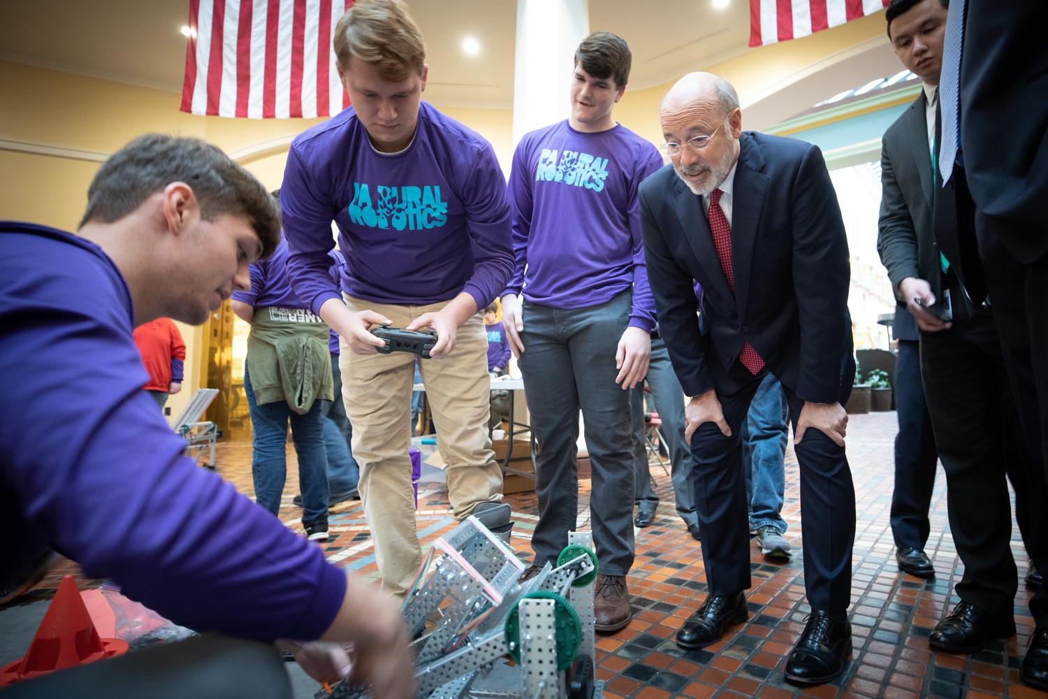"""<a href=""""https://filesource.wostreaming.net/commonwealthofpa/photo/17587_gov_pasmart_rural_robotics_dz_016.jpg"""" target=""""_blank"""">⇣Download Photo<br></a>Pennsylvania Governor Tom Wolf meeting with students at the robotics demonstration.  Celebrating the success of the PAsmart workforce development program to create educational opportunities at schools across the commonwealth, Governor Tom Wolf welcomed more than 50 students from the Pennsylvania Rural Robotics Initiative to the Capitol today. The students from nine western Pennsylvania school districts showcased their skills in coding, robotics and drone technology. The Wolf administration awarded the initiative a $299,000 PAsmart Advancing Grant earlier this year. Harrisburg, PA  Tuesday, November 12, 2019"""
