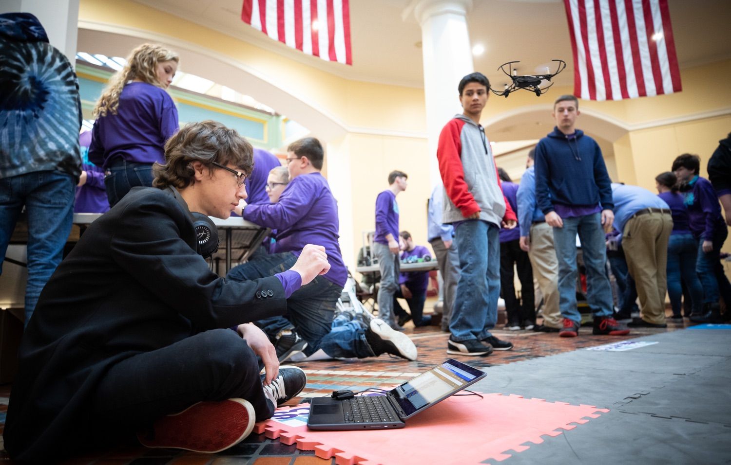 """<a href=""""https://filesource.wostreaming.net/commonwealthofpa/photo/17587_gov_pasmart_rural_robotics_dz_021.jpg"""" target=""""_blank"""">⇣Download Photo<br></a>Students fly a drone during the robotics demonstration.  Celebrating the success of the PAsmart workforce development program to create educational opportunities at schools across the commonwealth, Governor Tom Wolf welcomed more than 50 students from the Pennsylvania Rural Robotics Initiative to the Capitol today. The students from nine western Pennsylvania school districts showcased their skills in coding, robotics and drone technology. The Wolf administration awarded the initiative a $299,000 PAsmart Advancing Grant earlier this year. Harrisburg, PA  Tuesday, November 12, 2019"""