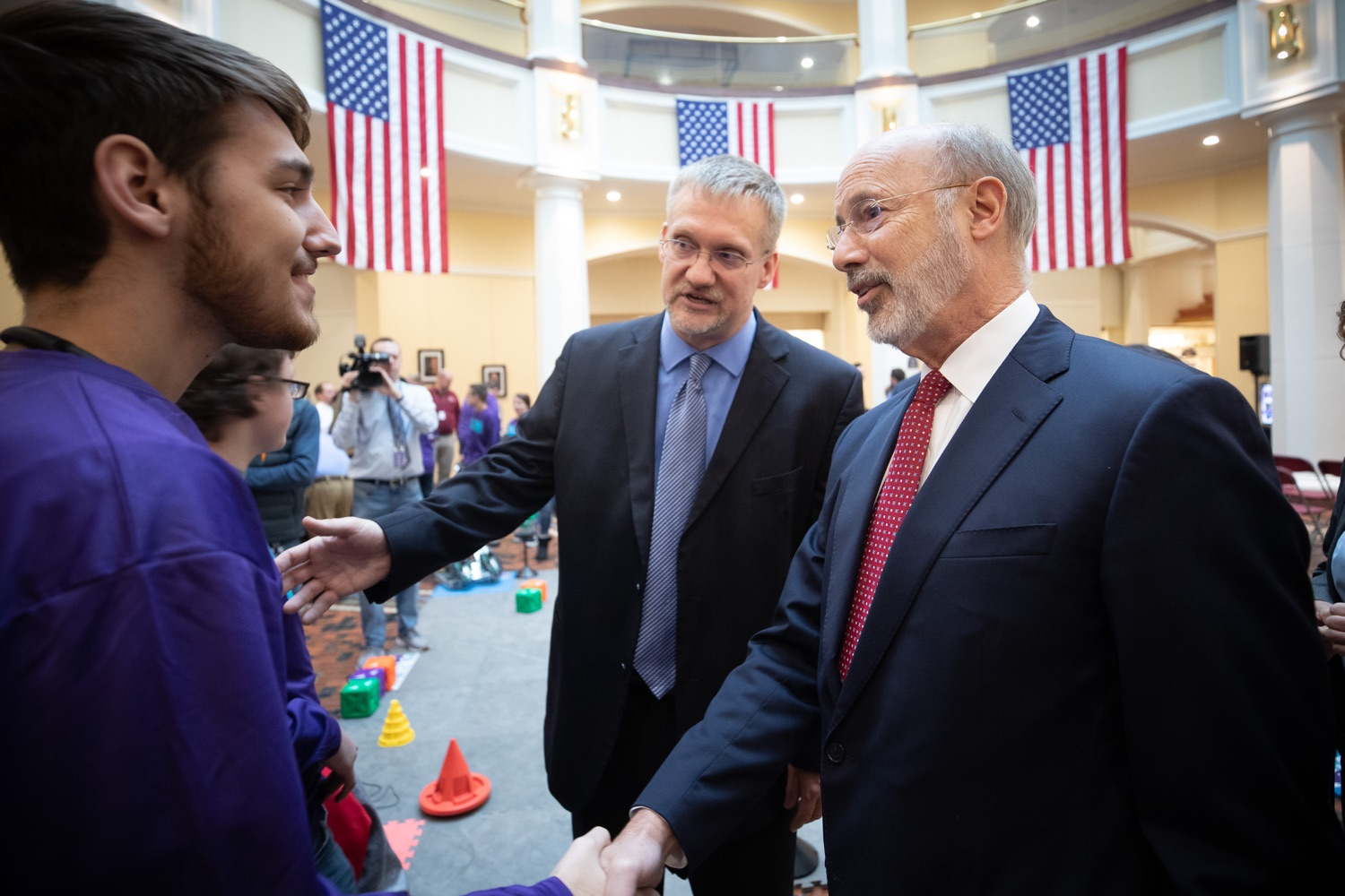 """<a href=""""https://filesource.wostreaming.net/commonwealthofpa/photo/17587_gov_pasmart_rural_robotics_dz_022.jpg"""" target=""""_blank"""">⇣Download Photo<br></a>Pennsylvania Governor Tom Wolf meeting with students at the robotics demonstration.Celebrating the success of the PAsmart workforce development program to create educational opportunities at schools across the commonwealth, Governor Tom Wolf welcomed more than 50 students from the Pennsylvania Rural Robotics Initiative to the Capitol today. The students from nine western Pennsylvania school districts showcased their skills in coding, robotics and drone technology. The Wolf administration awarded the initiative a $299,000 PAsmart Advancing Grant earlier this year. Harrisburg, PA  Tuesday, November 12, 2019"""
