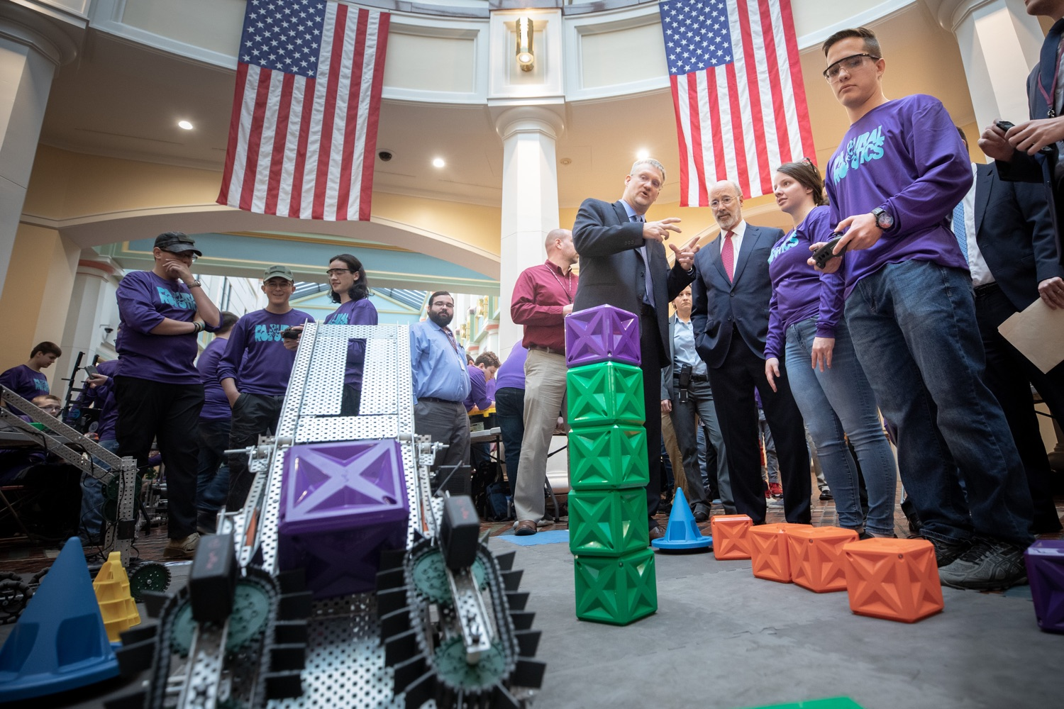 """<a href=""""https://filesource.wostreaming.net/commonwealthofpa/photo/17587_gov_pasmart_rural_robotics_dz_023.jpg"""" target=""""_blank"""">⇣Download Photo<br></a>Pennsylvania Governor Tom Wolf meeting with students at the robotics demonstration.Celebrating the success of the PAsmart workforce development program to create educational opportunities at schools across the commonwealth, Governor Tom Wolf welcomed more than 50 students from the Pennsylvania Rural Robotics Initiative to the Capitol today. The students from nine western Pennsylvania school districts showcased their skills in coding, robotics and drone technology. The Wolf administration awarded the initiative a $299,000 PAsmart Advancing Grant earlier this year. Harrisburg, PA  Tuesday, November 12, 2019"""