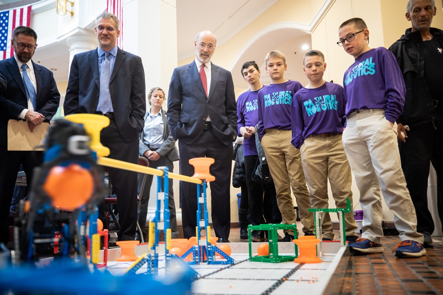 """<a href=""""https://filesource.wostreaming.net/commonwealthofpa/photo/17587_gov_pasmart_rural_robotics_dz_024.jpg"""" target=""""_blank"""">⇣Download Photo<br></a>Pennsylvania Governor Tom Wolf meeting with students at the robotics demonstration.Celebrating the success of the PAsmart workforce development program to create educational opportunities at schools across the commonwealth, Governor Tom Wolf welcomed more than 50 students from the Pennsylvania Rural Robotics Initiative to the Capitol today. The students from nine western Pennsylvania school districts showcased their skills in coding, robotics and drone technology. The Wolf administration awarded the initiative a $299,000 PAsmart Advancing Grant earlier this year. Harrisburg, PA  Tuesday, November 12, 2019"""