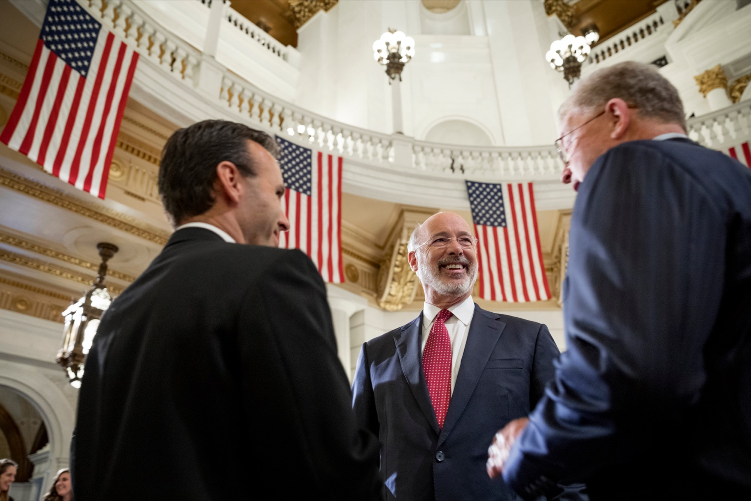 """<a href=""""https://filesource.wostreaming.net/commonwealthofpa/photo/17588_GOV_Mission_Readiness_NK_001.JPG"""" target=""""_blank"""">⇣Download Photo<br></a>Pennsylvania Governor Tom Wolf, center, speaks with Steve Doster, director of Mission:Readiness, left, and Rear Admiral Thomas Wilson, USN (Ret.), right, during a press conference outlining how competition for qualified individuals among all employment sectors affects military recruiting efforts and warrants greater investment in our next generation inside the Capitol Rotunda on Tuesday, November 12, 2019."""
