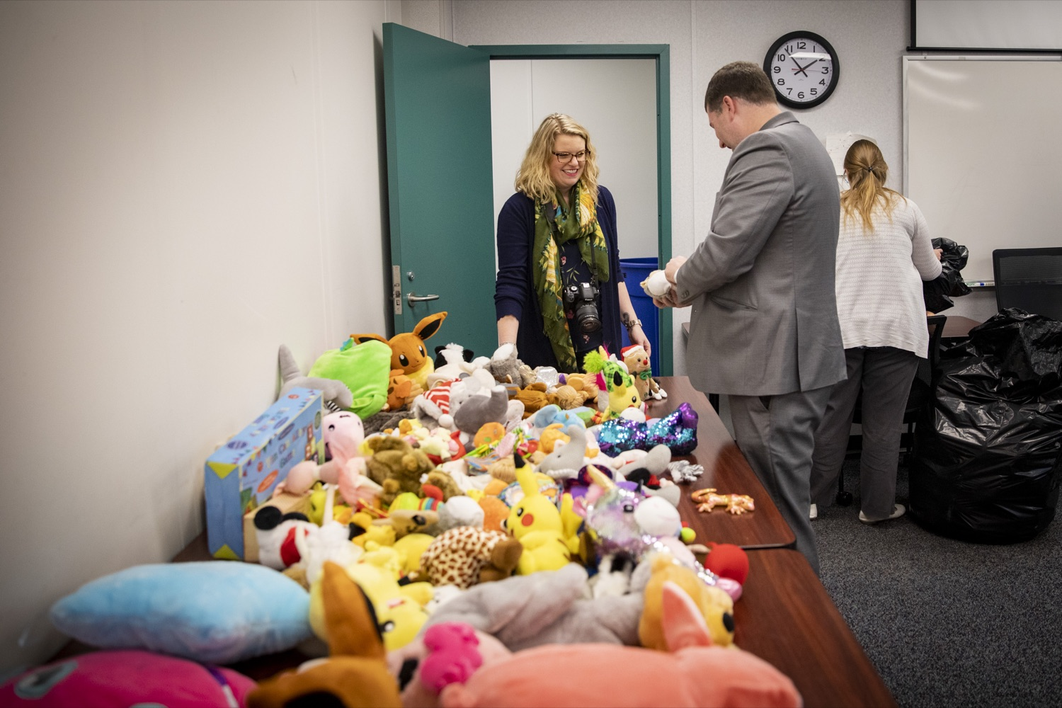 """<a href=""""https://filesource.wostreaming.net/commonwealthofpa/photo/17589_LandI_TOY_DONATION_CZ_01.JPG"""" target=""""_blank"""">⇣Download Photo<br></a>Employees from the Department of Labor and Industry gather 900 toys for donation in Harrisburg on November 14, 2019. These toys passed safety inspections and will be given to the commonwealths 30th annual Holiday Wish program gift drive."""