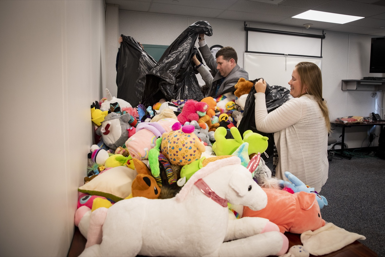 """<a href=""""https://filesource.wostreaming.net/commonwealthofpa/photo/17589_LandI_TOY_DONATION_CZ_11.JPG"""" target=""""_blank"""">⇣Download Photo<br></a>Employees from the Department of Labor and Industry gather 900 toys for donation in Harrisburg on November 14, 2019. These toys passed safety inspections and will be given to the commonwealths 30th annual Holiday Wish program gift drive."""