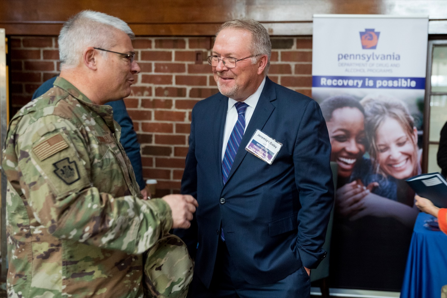 "<a href=""https://filesource.wostreaming.net/commonwealthofpa/photo/17596_DDAP_Psychostimulants_NK_002.JPG"" target=""_blank"">⇣ Download Photo<br></a>Maj. Gen. Anthony Carrelli, Pennsylvania's adjutant general, left, speaks with Jeremiah Daley, executive director of the Liberty Mid-Atlantic High Intensity Drug Trafficking Area, during a symposium addressing the rising trend of stimulant usage across the commonwealth, at the Best Western Premier in Harrisburg on Tuesday, November 19, 2019."