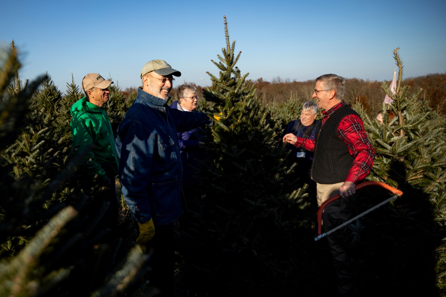 """<a href=""""https://filesource.wostreaming.net/commonwealthofpa/photo/17615_GOV_AGRIC_Christmas_Trees_NK_001.JPG"""" target=""""_blank"""">⇣Download Photo<br></a>Pennsylvania Governor Tom Wolf, front left, and Pennsylvania Agriculture Secretary Russell Redding, front right, smile before cutting down a Christmas tree on Monday, November 25, 2019."""