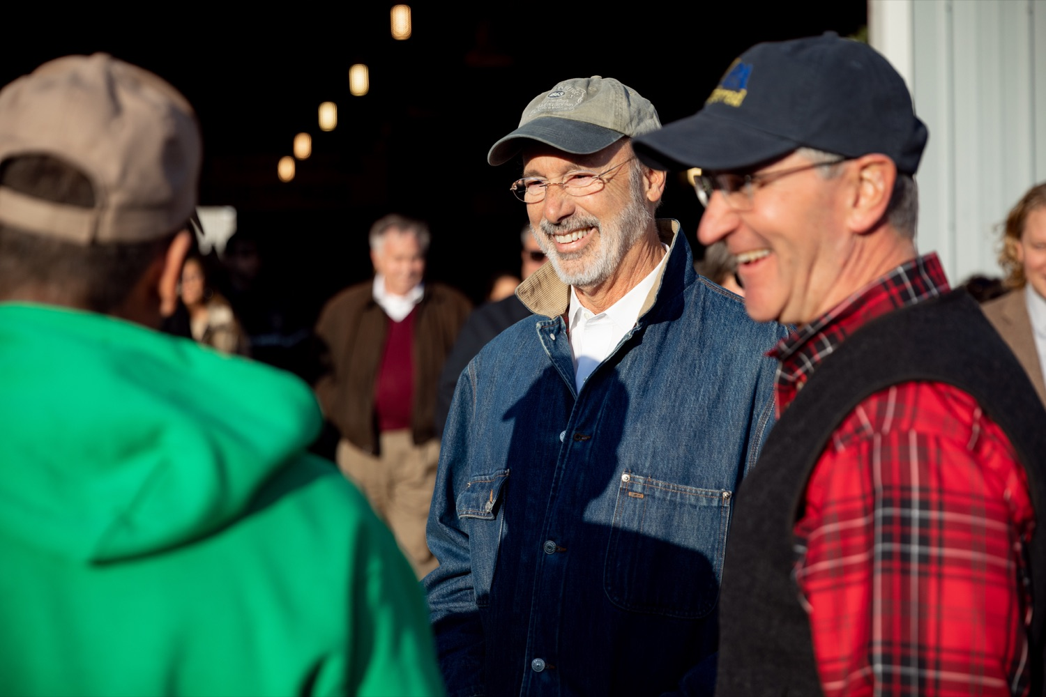 """<a href=""""https://filesource.wostreaming.net/commonwealthofpa/photo/17615_GOV_AGRIC_Christmas_Trees_NK_002.JPG"""" target=""""_blank"""">⇣Download Photo<br></a>Pennsylvania Governor Tom Wolf, center, Pennsylvania Agriculture Secretary Russell Redding laugh together on Monday, November 25, 2019."""