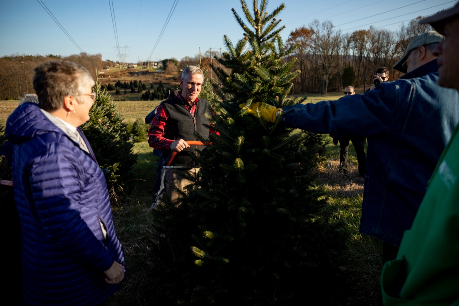 """<a href=""""https://filesource.wostreaming.net/commonwealthofpa/photo/17615_GOV_AGRIC_Christmas_Trees_NK_010.JPG"""" target=""""_blank"""">⇣Download Photo<br></a>Pennsylvania Agriculture Secretary Russell Redding smiles with his wife, Nina, left, before cutting down a Christmas tree on Monday, November 25, 2019."""