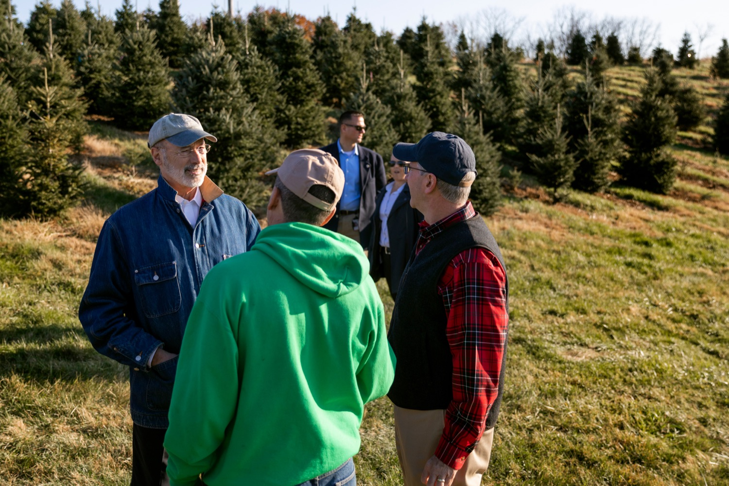"""<a href=""""https://filesource.wostreaming.net/commonwealthofpa/photo/17615_GOV_AGRIC_Christmas_Trees_NK_012.JPG"""" target=""""_blank"""">⇣Download Photo<br></a>Pennsylvania Governor Tom Wolf, left, Pennsylvania Agriculture Secretary Russell Redding, right and Mark McCurdy, owner of McCurdy's Tree Farm & Landscaping, talk together on Monday, November 25, 2019."""