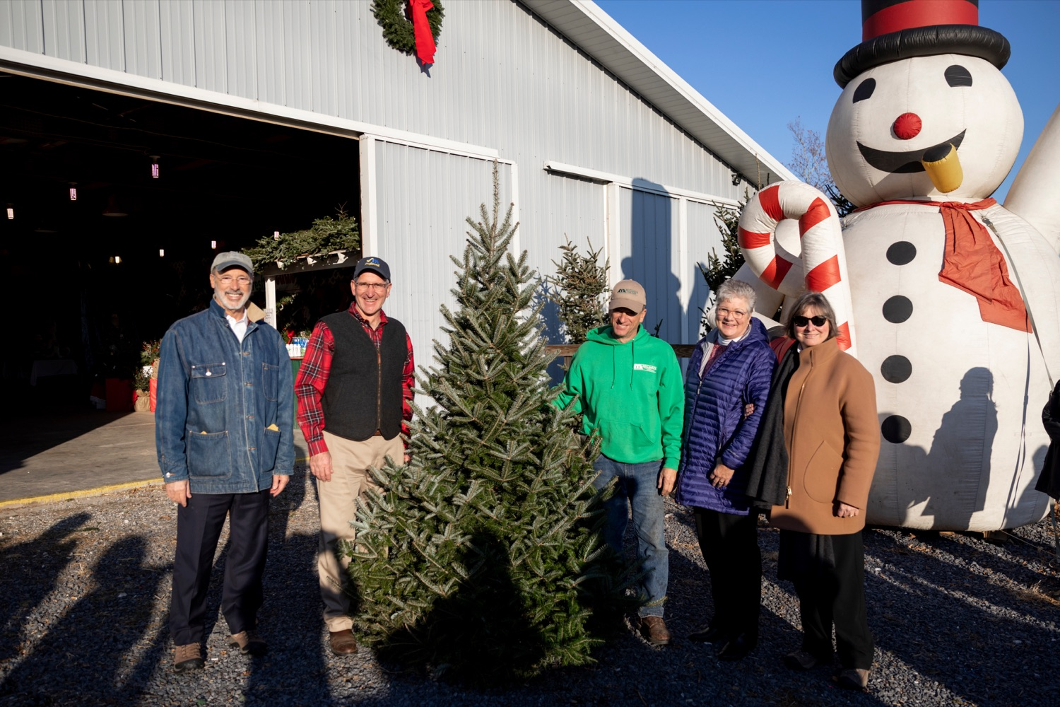 """<a href=""""https://filesource.wostreaming.net/commonwealthofpa/photo/17615_GOV_AGRIC_Christmas_Trees_NK_013.JPG"""" target=""""_blank"""">⇣Download Photo<br></a>From left; Pennsylvania Governor Tom Wolf; Pennsylvania Agriculture Secretary Russell Redding; Mark McCurdy, owner of McCurdy's Tree Farm & Landscaping; Nina Redding and Frances Wolf pose for a picture together on Monday, November 25, 2019."""