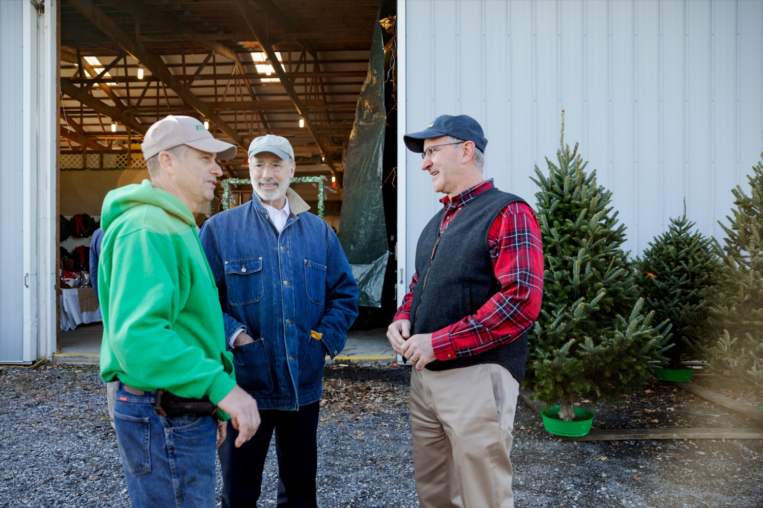 """<a href=""""https://filesource.wostreaming.net/commonwealthofpa/photo/17615_GOV_AGRIC_Christmas_Trees_NK_015.JPG"""" target=""""_blank"""">⇣Download Photo<br></a>Pennsylvania Governor Tom Wolf, center, Pennsylvania Agriculture Secretary Russell Redding, right and Mark McCurdy, owner of McCurdy's Tree Farm & Landscaping, talk together on Monday, November 25, 2019."""