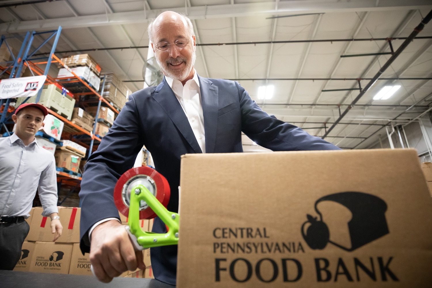 "<a href=""https://filesource.wostreaming.net/commonwealthofpa/photo/17632_gov_foodbank_volunteering_dz_001.jpg"" target=""_blank"">⇣ Download Photo<br></a>Governor Tom Wolf loading boxes of food at the Central Pennsylvania Food Bank.  The governor and first lady visit the Central Pennsylvania Food Bank in Harrisburg to participate in a volunteer project, packing boxes of food for veterans and their families. Ahead of Thanksgiving and the holiday season, Governor Tom Wolf and First Lady Frances Wolf are reminding Pennsylvanians of the importance of helping each other. Harrisburg, PA  Tuesday November 26, 2019"