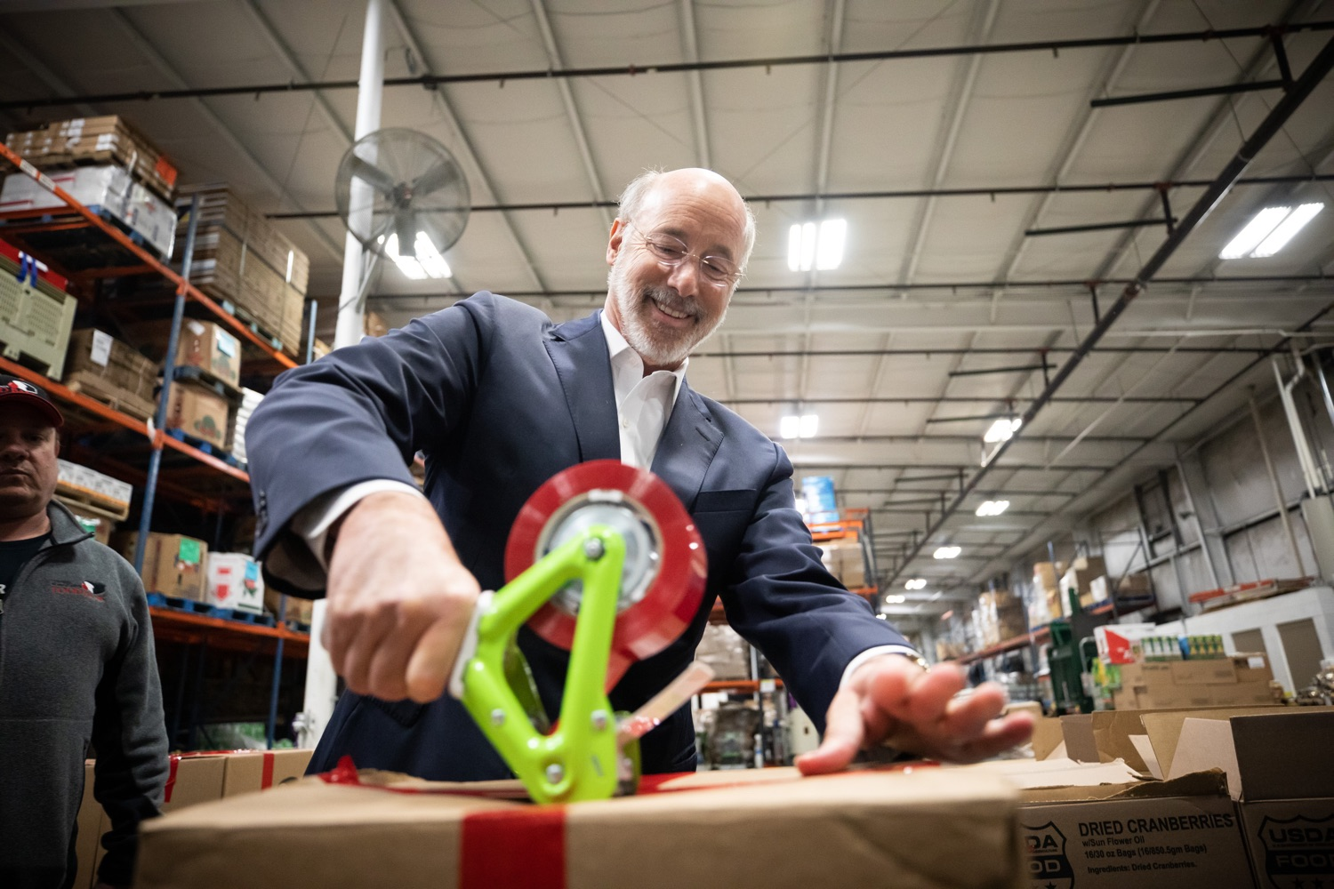 "<a href=""https://filesource.wostreaming.net/commonwealthofpa/photo/17632_gov_foodbank_volunteering_dz_002.jpg"" target=""_blank"">⇣ Download Photo<br></a>Governor Tom Wolf loading boxes of food at the Central Pennsylvania Food Bank.  The governor and first lady visit the Central Pennsylvania Food Bank in Harrisburg to participate in a volunteer project, packing boxes of food for veterans and their families. Ahead of Thanksgiving and the holiday season, Governor Tom Wolf and First Lady Frances Wolf are reminding Pennsylvanians of the importance of helping each other. Harrisburg, PA  Tuesday November 26, 2019"