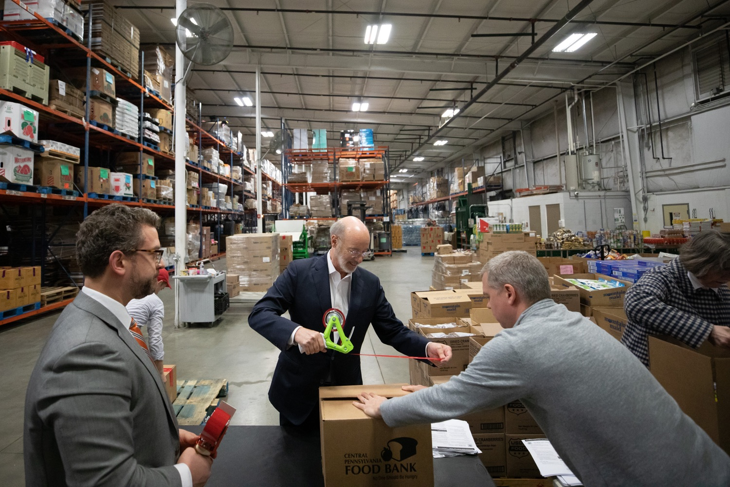 "<a href=""https://filesource.wostreaming.net/commonwealthofpa/photo/17632_gov_foodbank_volunteering_dz_003.jpg"" target=""_blank"">⇣ Download Photo<br></a>Governor Tom Wolf loading boxes of food at the Central Pennsylvania Food Bank.  The governor and first lady visit the Central Pennsylvania Food Bank in Harrisburg to participate in a volunteer project, packing boxes of food for veterans and their families. Ahead of Thanksgiving and the holiday season, Governor Tom Wolf and First Lady Frances Wolf are reminding Pennsylvanians of the importance of helping each other. Harrisburg, PA  Tuesday November 26, 2019"