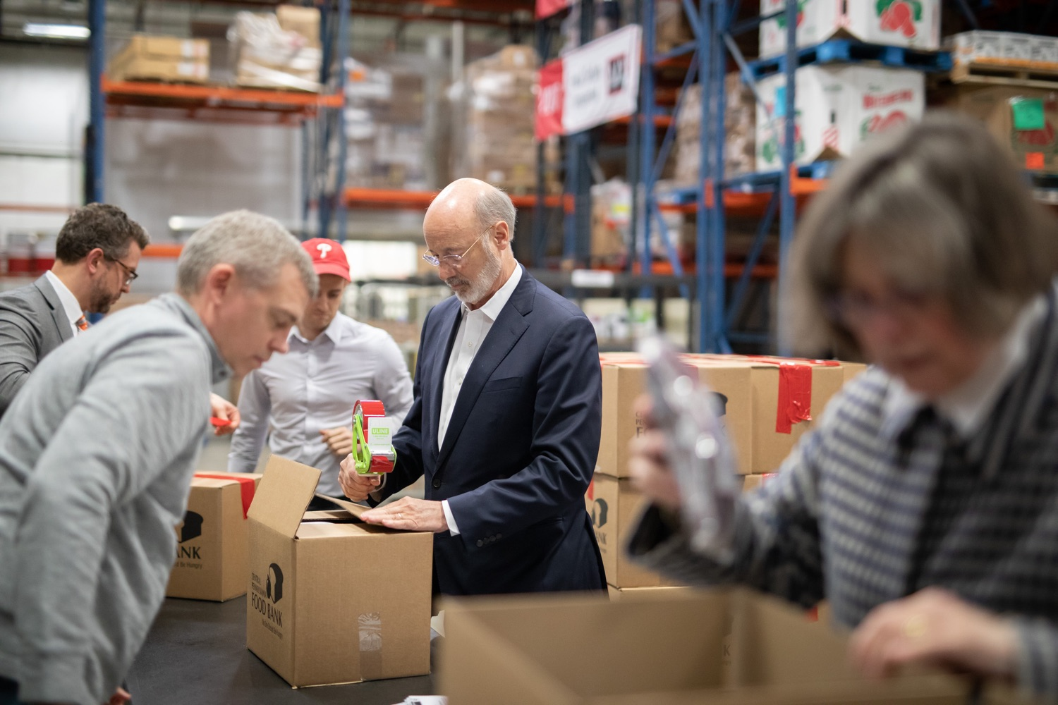 "<a href=""https://filesource.wostreaming.net/commonwealthofpa/photo/17632_gov_foodbank_volunteering_dz_007.jpg"" target=""_blank"">⇣ Download Photo<br></a>Governor Tom Wolf loading boxes of food at the Central Pennsylvania Food Bank.  The governor and first lady visit the Central Pennsylvania Food Bank in Harrisburg to participate in a volunteer project, packing boxes of food for veterans and their families. Ahead of Thanksgiving and the holiday season, Governor Tom Wolf and First Lady Frances Wolf are reminding Pennsylvanians of the importance of helping each other. Harrisburg, PA  Tuesday November 26, 2019"