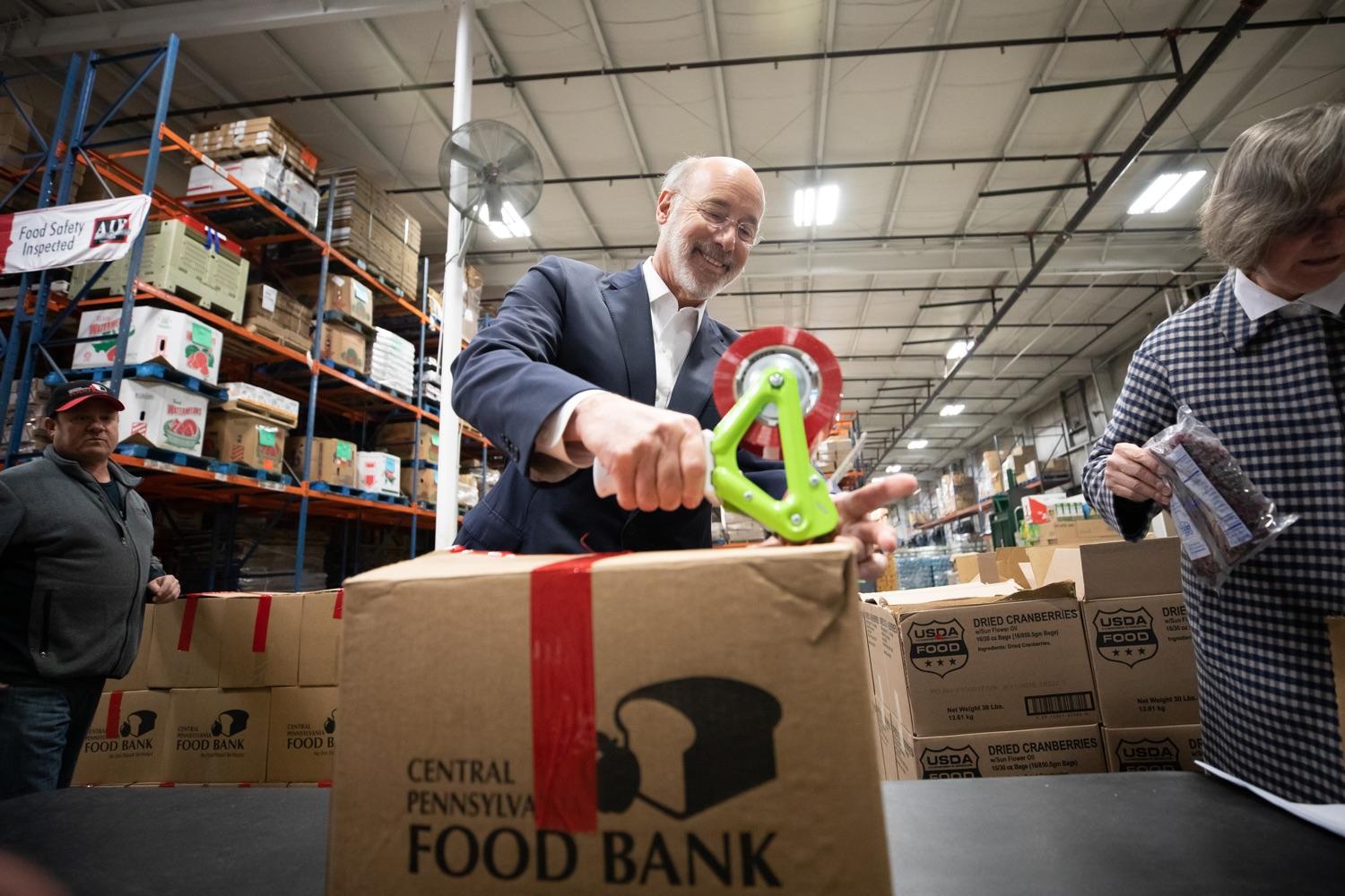 "<a href=""https://filesource.wostreaming.net/commonwealthofpa/photo/17632_gov_foodbank_volunteering_dz_013.jpg"" target=""_blank"">⇣ Download Photo<br></a>Governor Tom Wolf loading boxes of food at the Central Pennsylvania Food Bank.  The governor and first lady visit the Central Pennsylvania Food Bank in Harrisburg to participate in a volunteer project, packing boxes of food for veterans and their families. Ahead of Thanksgiving and the holiday season, Governor Tom Wolf and First Lady Frances Wolf are reminding Pennsylvanians of the importance of helping each other. Harrisburg, PA  Tuesday November 26, 2019"