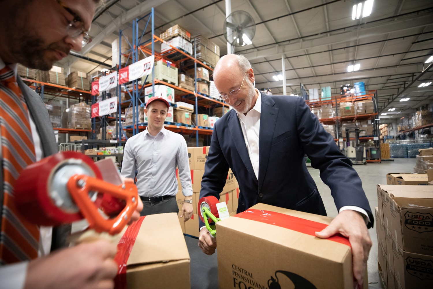 "<a href=""https://filesource.wostreaming.net/commonwealthofpa/photo/17632_gov_foodbank_volunteering_dz_015.jpg"" target=""_blank"">⇣ Download Photo<br></a>Governor Tom Wolf loading boxes of food at the Central Pennsylvania Food Bank.  The governor and first lady visit the Central Pennsylvania Food Bank in Harrisburg to participate in a volunteer project, packing boxes of food for veterans and their families. Ahead of Thanksgiving and the holiday season, Governor Tom Wolf and First Lady Frances Wolf are reminding Pennsylvanians of the importance of helping each other. Harrisburg, PA  Tuesday November 26, 2019"