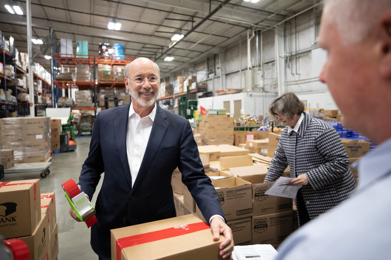 "<a href=""https://filesource.wostreaming.net/commonwealthofpa/photo/17632_gov_foodbank_volunteering_dz_016.jpg"" target=""_blank"">⇣ Download Photo<br></a>Governor Tom Wolf loading boxes of food at the Central Pennsylvania Food Bank.  The governor and first lady visit the Central Pennsylvania Food Bank in Harrisburg to participate in a volunteer project, packing boxes of food for veterans and their families. Ahead of Thanksgiving and the holiday season, Governor Tom Wolf and First Lady Frances Wolf are reminding Pennsylvanians of the importance of helping each other. Harrisburg, PA  Tuesday November 26, 2019"