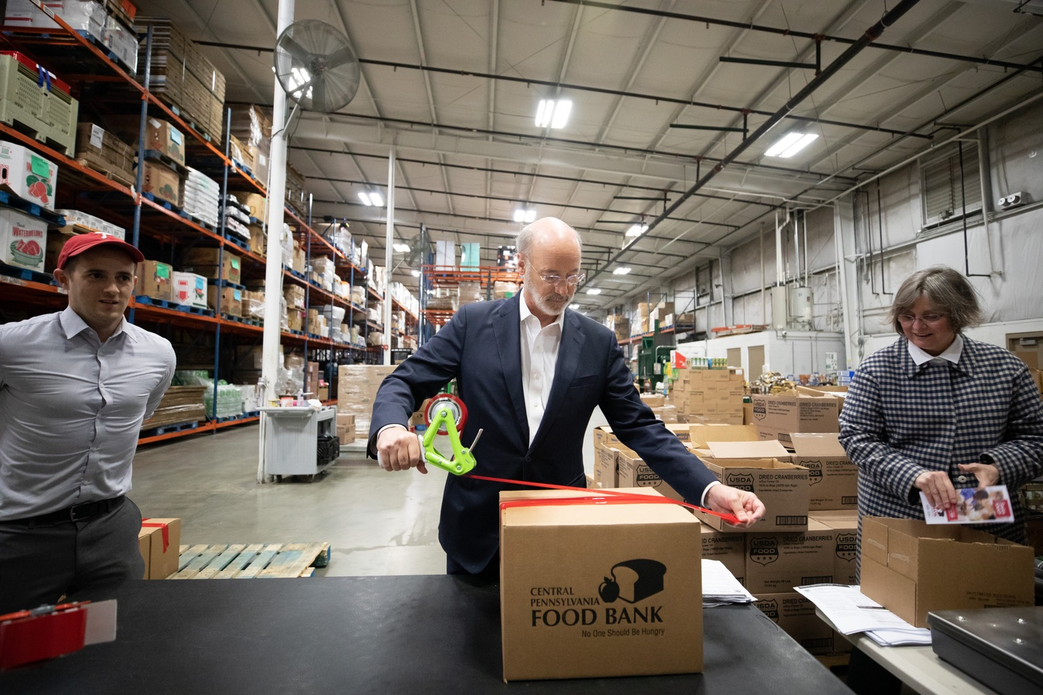 "<a href=""https://filesource.wostreaming.net/commonwealthofpa/photo/17632_gov_foodbank_volunteering_dz_017.jpg"" target=""_blank"">⇣ Download Photo<br></a>Governor Tom Wolf loading boxes of food at the Central Pennsylvania Food Bank.  The governor and first lady visit the Central Pennsylvania Food Bank in Harrisburg to participate in a volunteer project, packing boxes of food for veterans and their families. Ahead of Thanksgiving and the holiday season, Governor Tom Wolf and First Lady Frances Wolf are reminding Pennsylvanians of the importance of helping each other. Harrisburg, PA  Tuesday November 26, 2019"