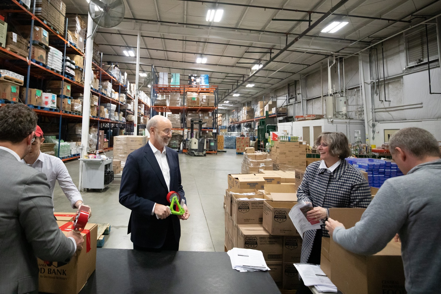 "<a href=""https://filesource.wostreaming.net/commonwealthofpa/photo/17632_gov_foodbank_volunteering_dz_018.jpg"" target=""_blank"">⇣ Download Photo<br></a>Governor Tom Wolf loading boxes of food at the Central Pennsylvania Food Bank.  The governor and first lady visit the Central Pennsylvania Food Bank in Harrisburg to participate in a volunteer project, packing boxes of food for veterans and their families. Ahead of Thanksgiving and the holiday season, Governor Tom Wolf and First Lady Frances Wolf are reminding Pennsylvanians of the importance of helping each other. Harrisburg, PA  Tuesday November 26, 2019"