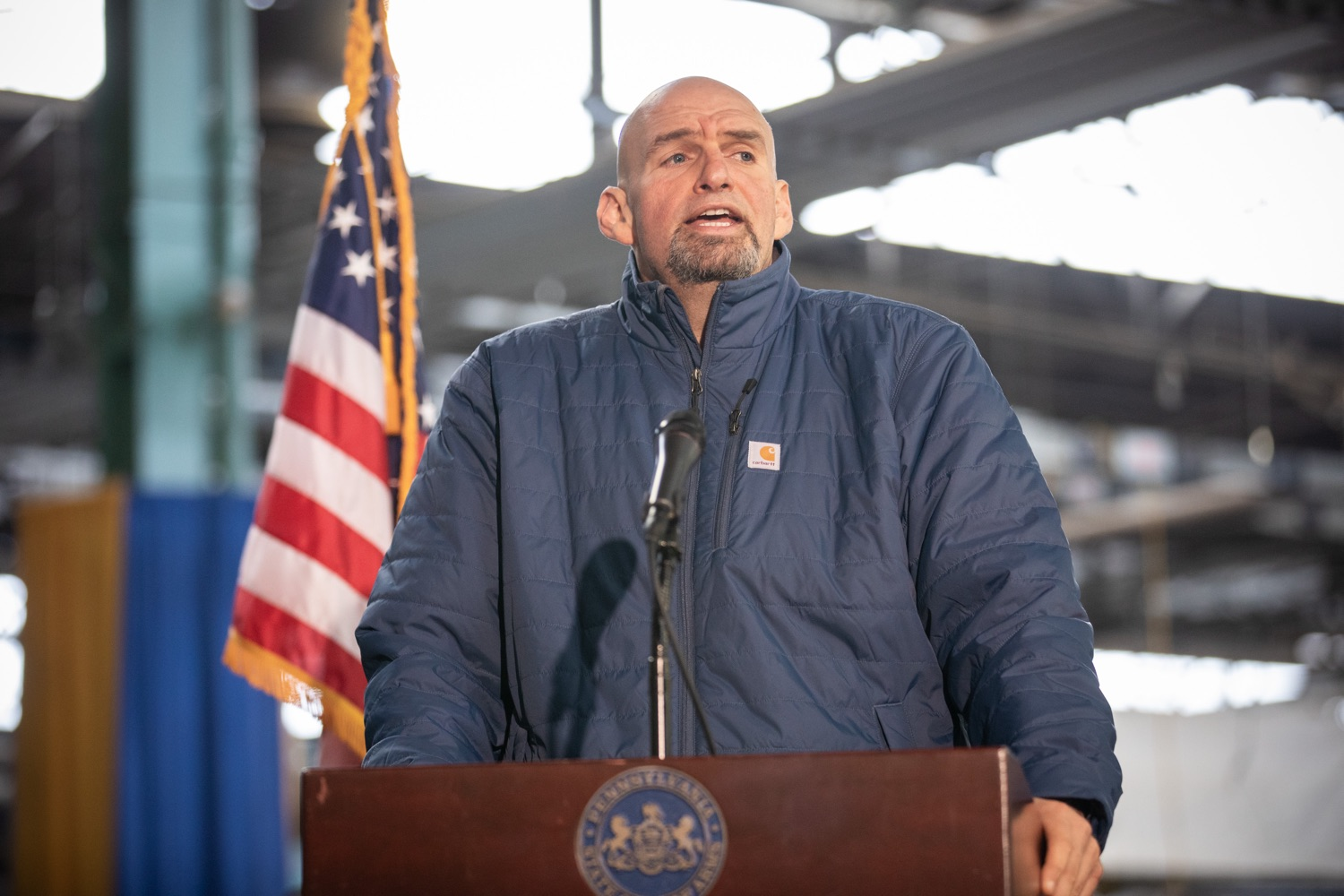 "<a href=""https://filesource.wostreaming.net/commonwealthofpa/photo/17646_agric_butter_sculpture_dz_011.jpg"" target=""_blank"">⇣ Download Photo<br></a>Lt. Governor John Fetterman speaking at the Pennsylvania Farm Show butter sculpture unveiling.Lt. Governor John Fetterman and Secretary of Agriculture Russell Redding today unveiled the 2020 Pennsylvania Farm Show butter sculpture, carved from a half-ton of butter depicting three of Pennsylvanias beloved professional sports mascots: Philadelphia Flyers Gritty, Philadelphia Eagles Swoop, and Pittsburgh Steelers Steely McBeam celebrating with a spread of Pennsylvania dairy products. The sculpture, a long-time Farm Show staple, encourages Pennsylvanians to be a fan of Pennsylvania dairy and give a cheer to the more than 6,200 dairy farmers in the commonwealth.  Harrisburg, PA  January 2, 2020"