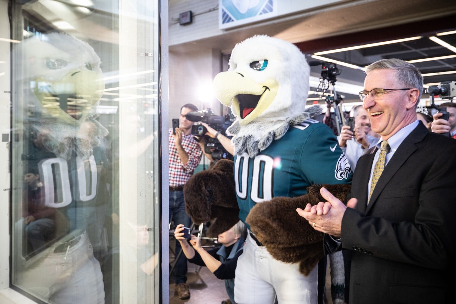 "<a href=""https://filesource.wostreaming.net/commonwealthofpa/photo/17646_agric_butter_sculpture_dz_019.jpg"" target=""_blank"">⇣ Download Photo<br></a>Philadelphia Eagles Swoop, and Secretary of Agriculture Russell Redding check out the Pennsylvania Farm Show butter sculpture.  Lt. Governor John Fetterman and Secretary of Agriculture Russell Redding today unveiled the 2020 Pennsylvania Farm Show butter sculpture, carved from a half-ton of butter depicting three of Pennsylvanias beloved professional sports mascots: Philadelphia Flyers Gritty, Philadelphia Eagles Swoop, and Pittsburgh Steelers Steely McBeam celebrating with a spread of Pennsylvania dairy products. The sculpture, a long-time Farm Show staple, encourages Pennsylvanians to be a fan of Pennsylvania dairy and give a cheer to the more than 6,200 dairy farmers in the commonwealth.  Harrisburg, PA  January 2, 2020"