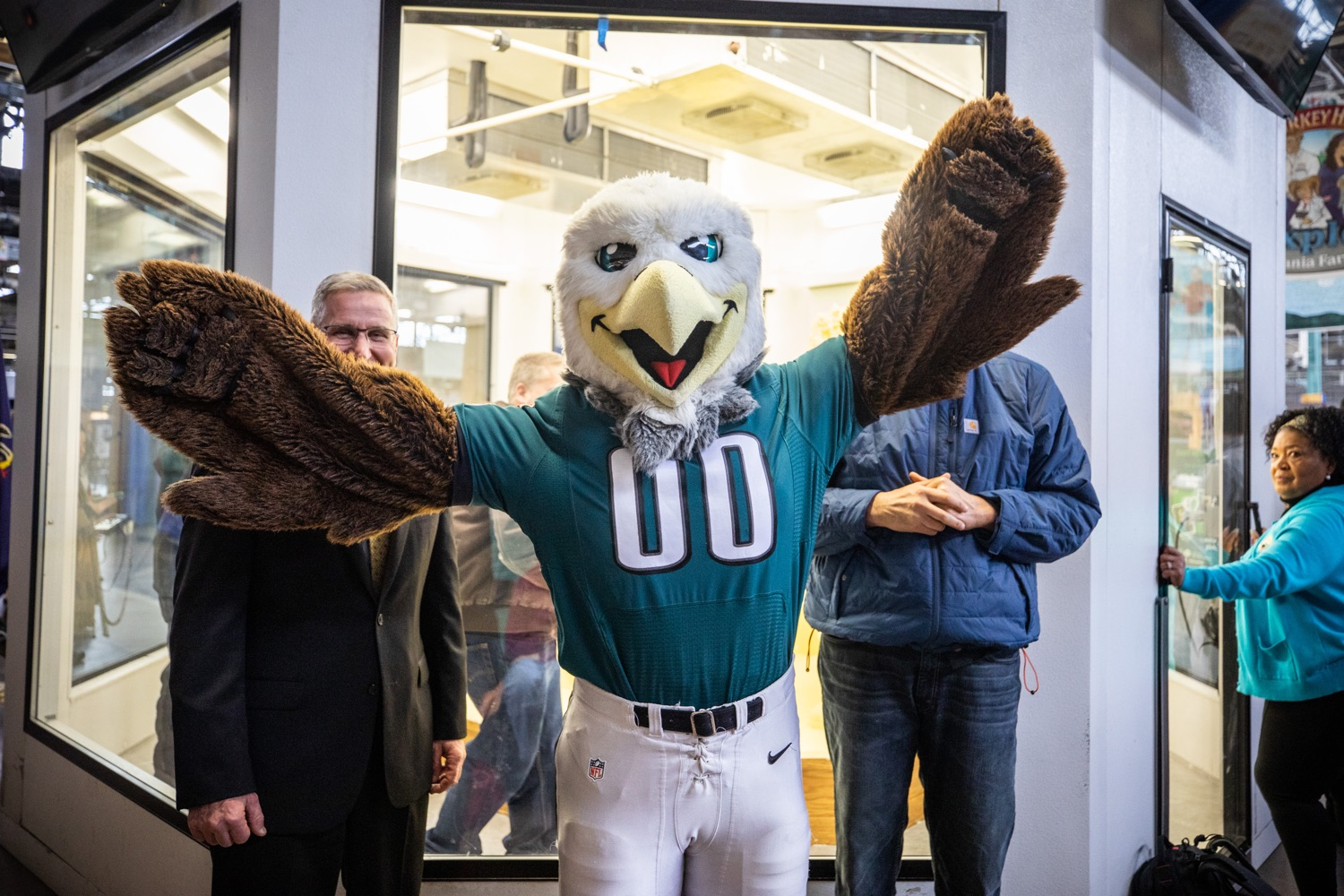 "<a href=""https://filesource.wostreaming.net/commonwealthofpa/photo/17646_agric_butter_sculpture_dz_021.jpg"" target=""_blank"">⇣ Download Photo<br></a>Philadelphia Eagles Swoop, Lt. Governor John Fetterman,  and Secretary of Agriculture Russell Redding at the Pennsylvania Farm Show butter sculpture.  Lt. Governor John Fetterman and Secretary of Agriculture Russell Redding today unveiled the 2020 Pennsylvania Farm Show butter sculpture, carved from a half-ton of butter depicting three of Pennsylvanias beloved professional sports mascots: Philadelphia Flyers Gritty, Philadelphia Eagles Swoop, and Pittsburgh Steelers Steely McBeam celebrating with a spread of Pennsylvania dairy products. The sculpture, a long-time Farm Show staple, encourages Pennsylvanians to be a fan of Pennsylvania dairy and give a cheer to the more than 6,200 dairy farmers in the commonwealth.  Harrisburg, PA  January 2, 2020"