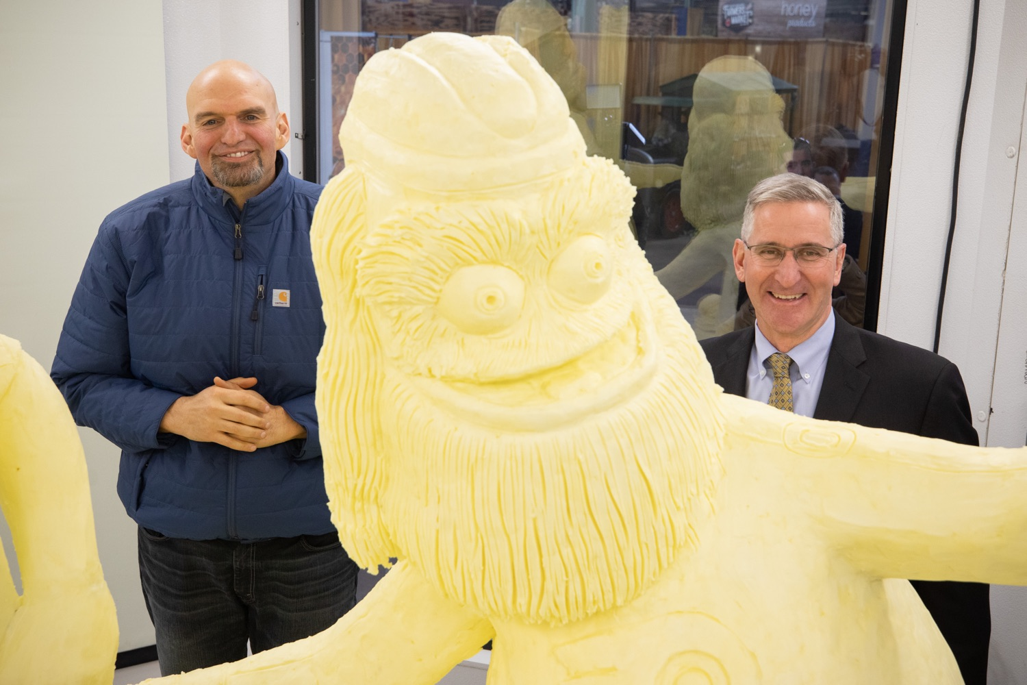 "<a href=""https://filesource.wostreaming.net/commonwealthofpa/photo/17646_agric_butter_sculpture_dz_023.jpg"" target=""_blank"">⇣ Download Photo<br></a>Lt. Governor John Fetterman,  and Secretary of Agriculture Russell Redding at the Pennsylvania Farm Show butter sculpture.  Lt. Governor John Fetterman and Secretary of Agriculture Russell Redding today unveiled the 2020 Pennsylvania Farm Show butter sculpture, carved from a half-ton of butter depicting three of Pennsylvanias beloved professional sports mascots: Philadelphia Flyers Gritty, Philadelphia Eagles Swoop, and Pittsburgh Steelers Steely McBeam celebrating with a spread of Pennsylvania dairy products. The sculpture, a long-time Farm Show staple, encourages Pennsylvanians to be a fan of Pennsylvania dairy and give a cheer to the more than 6,200 dairy farmers in the commonwealth.  Harrisburg, PA  January 2, 2020"